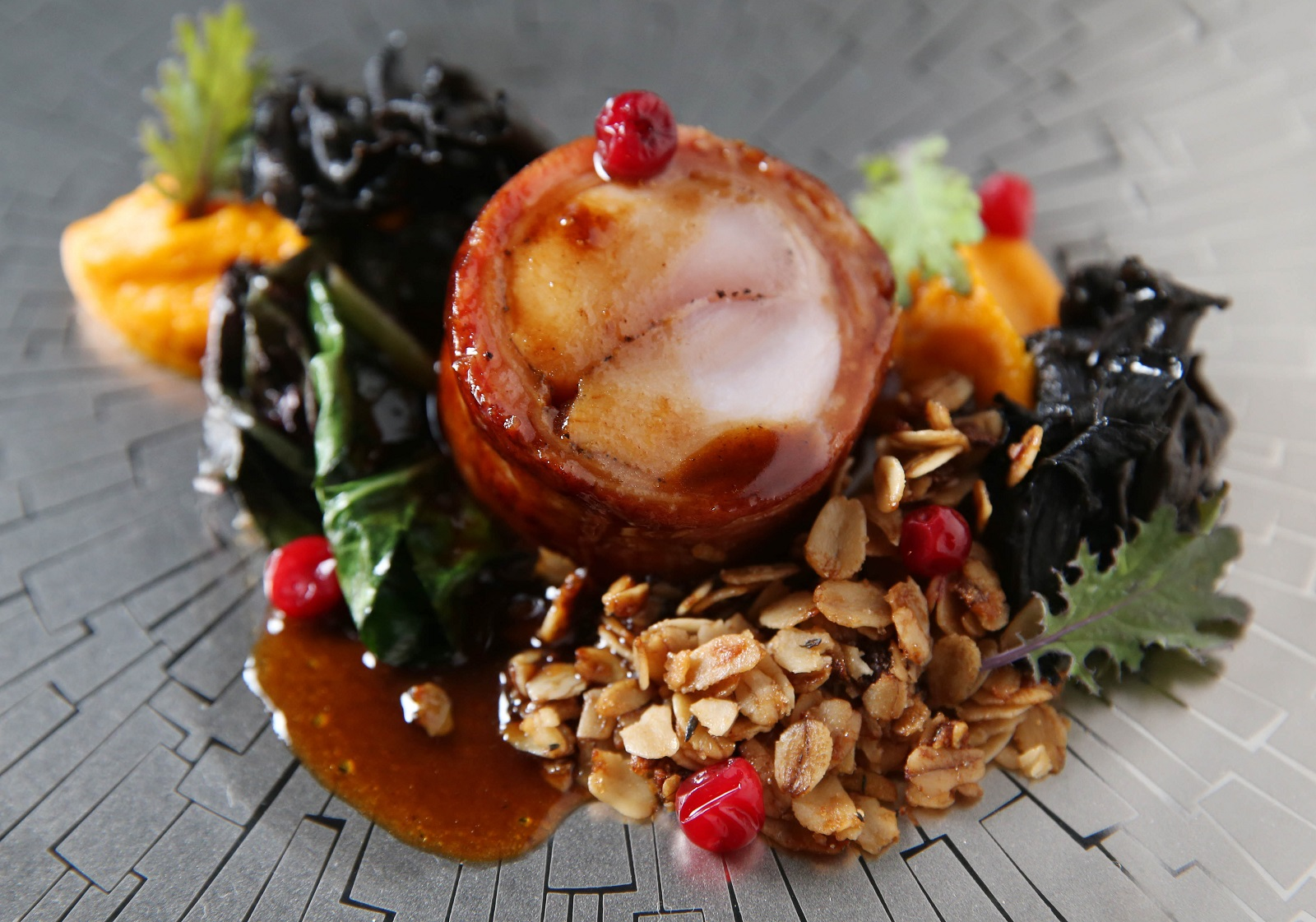 Oliver's fifth course is Elmer's Revenge which is sous vide saddle, carrot pudding, oat crumble, black trumpet mushrooms and lingonberries. (Sharon Cantillon/Buffalo News)