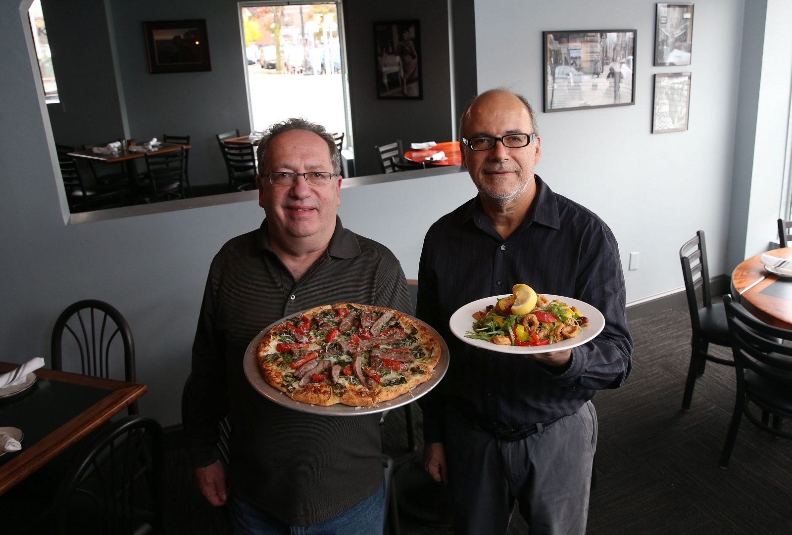 Giacobbi's Cucina Citta owners and cousins Billy, left, and Mike Jacobbi present the spinach and steak pizza and shrimp pappardelle. (Sharon Cantillon/Buffalo News)