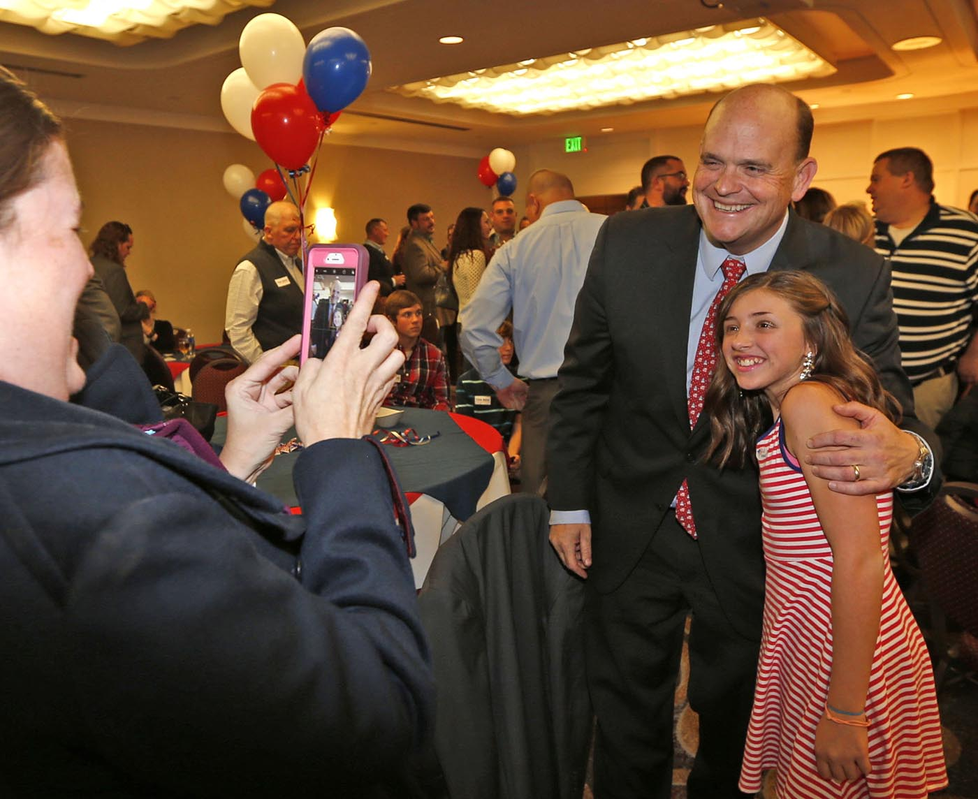 Rep. Tom Reed poses for a photo with Gianna Visconti, 11, of painted Post, NY, as her mom Michelle snaps the photo at his apparent victory party at the Radisson Hotel in Corning, NY onTuesday, Nov. 8, 2016. (Robert Kirkham/Buffalo News)