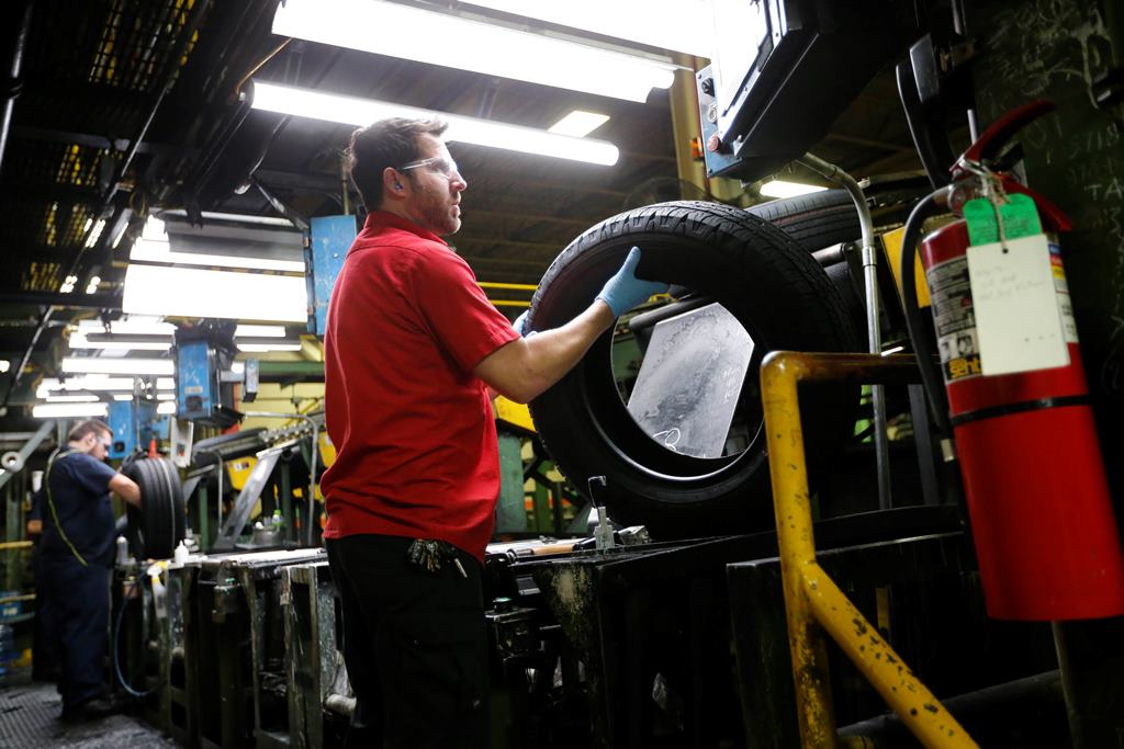 Workers put the final touches on Falken tires in the finishing area of the PCR line at the Sumitomo Rubber USA tire manufacturing plant in Tonawanda, Thursday, Nov. 10, 2016.  (Derek Gee/Buffalo News)