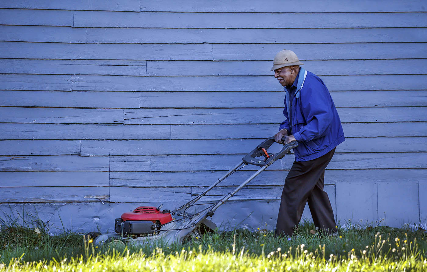 Henry Boyd takes advantage of the pleasant weather Monday to mow his lawn on Dodge Street in Buffalo, Nov. 7, 2016. (Derek Gee/Buffalo News)