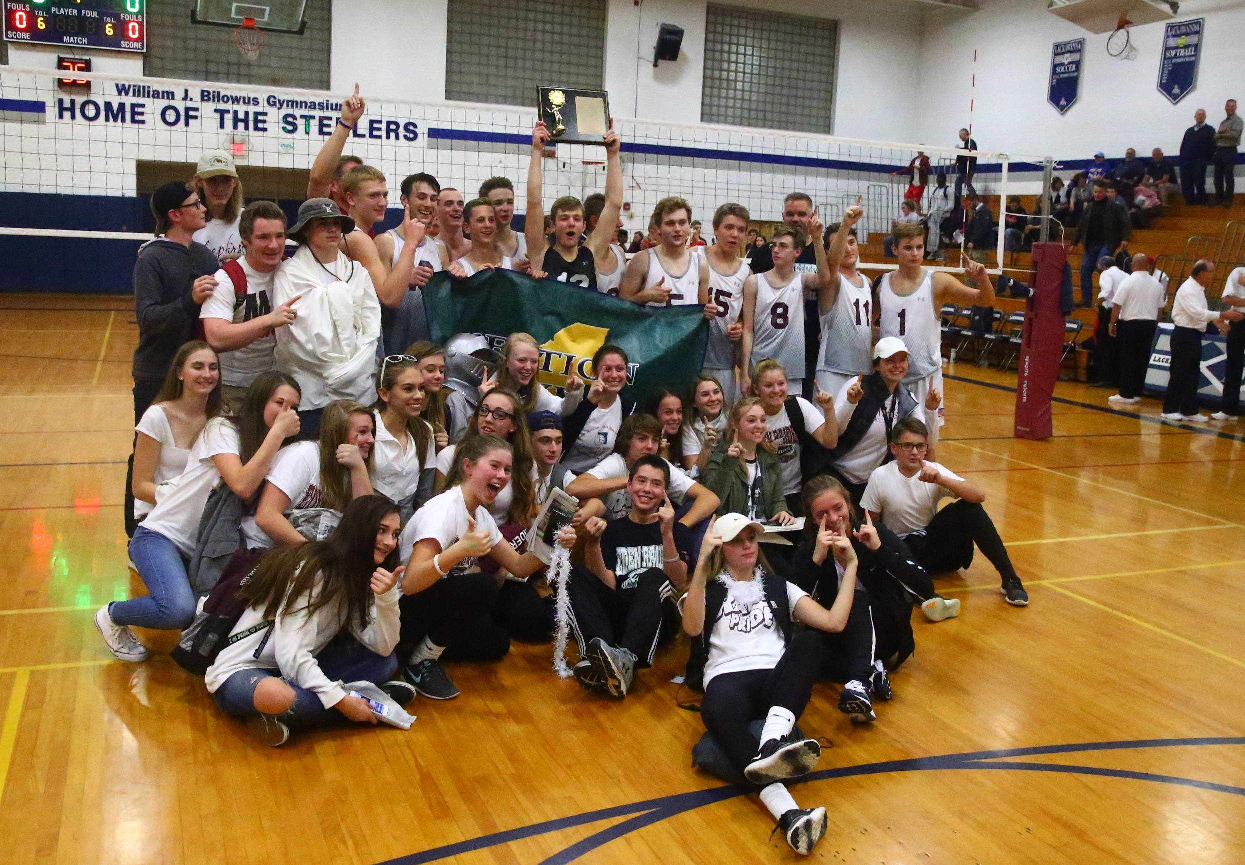 Eden celebrates its sweep of Maryvale with its supporters (John Hickey/Buffalo News)