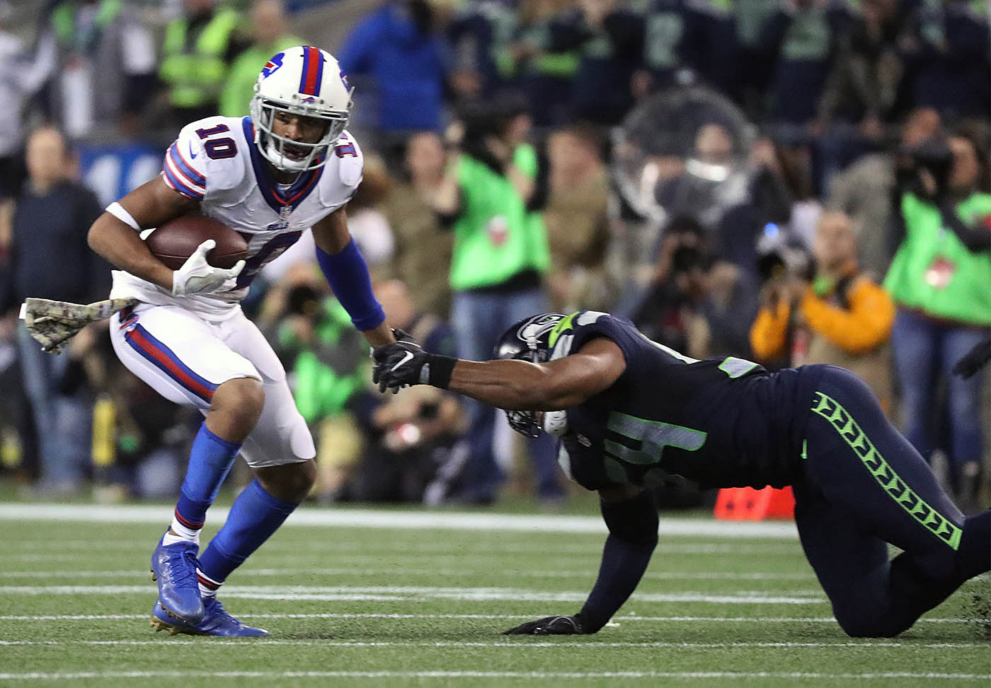 Buffalo Bills wide receiver Robert Woods (10) runs with the ball as Seattle Seahawks middle linebacker Bobby Wagner (54) tries to make a tackle during the third quarter of a game at CenturyLink Field in Seattle on Monday, Nov. 7, 2016. (James P. McCoy/Buffalo News)