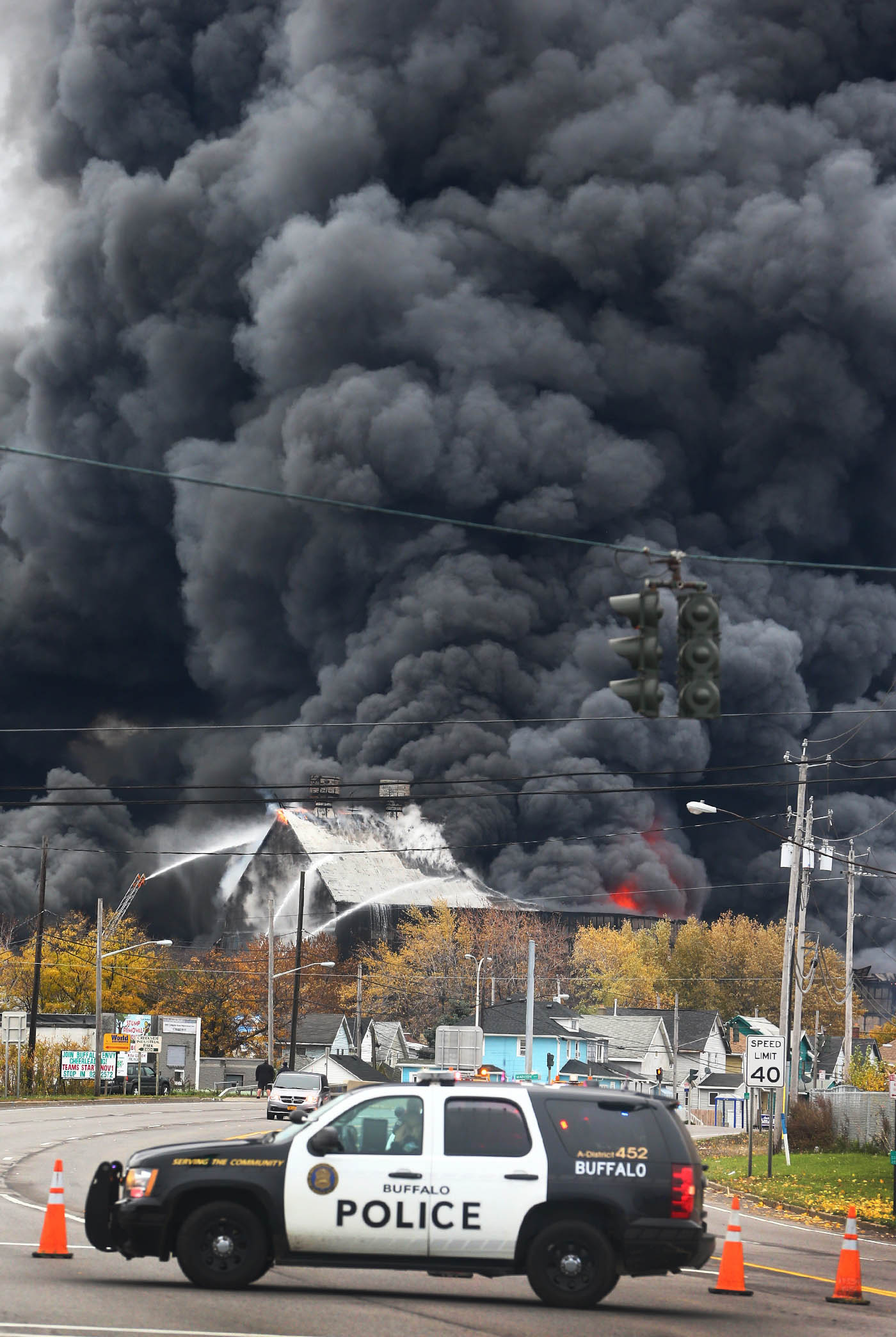 A Buffalo Police vehicle closes Route 5 as a fire rages at former Bethlehem Steel storage along Route 5, Lackawanna, N.Y., on Wednesday November 9, 2016. (John Hickey/Buffalo News)