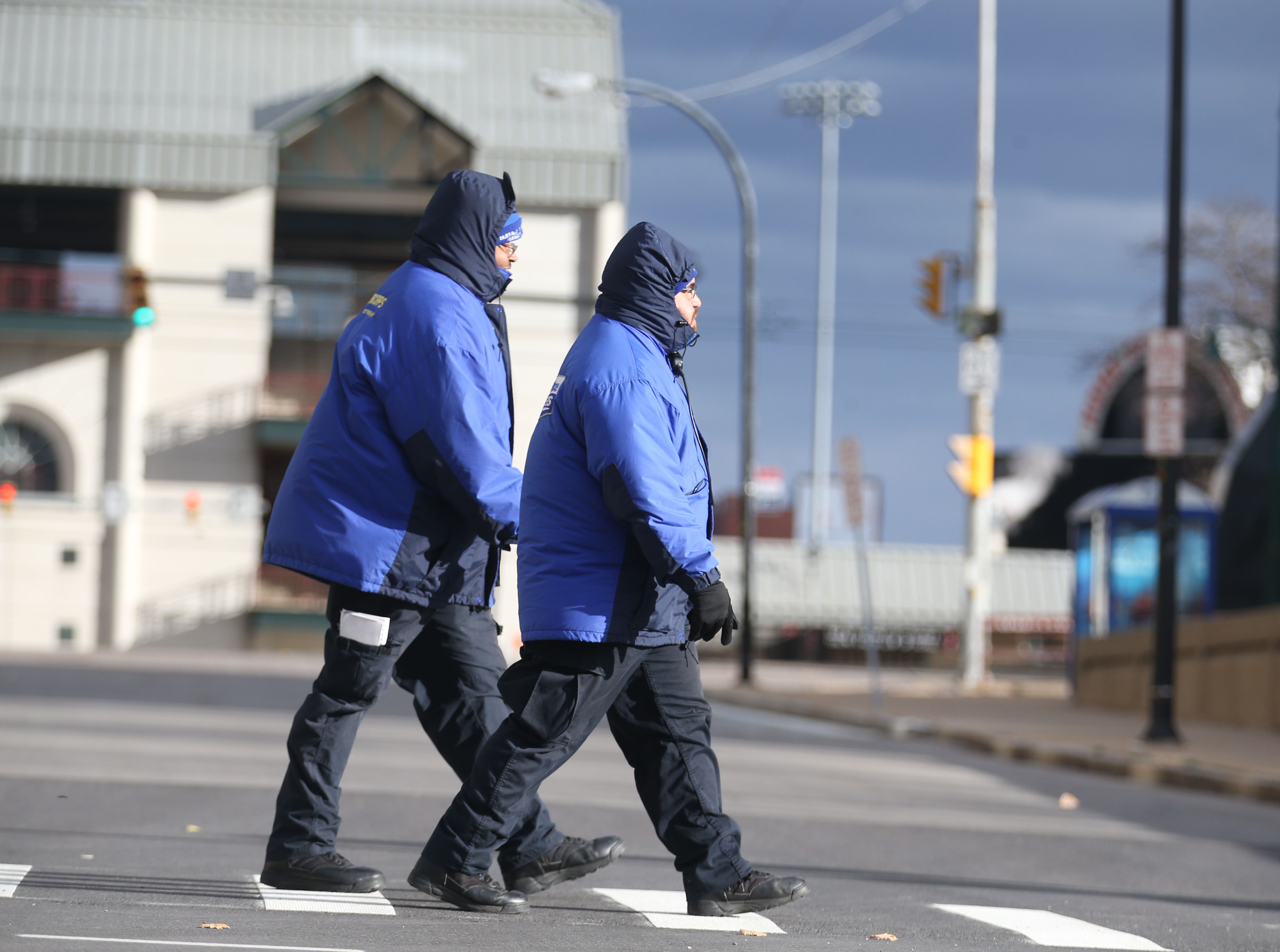 Gabriel Vazquez, right, and Melvin Stewart were bundled up as they crossed Seneca Street in Buffalo on Nov. 21.  (Sharon Cantillon/Buffalo News)