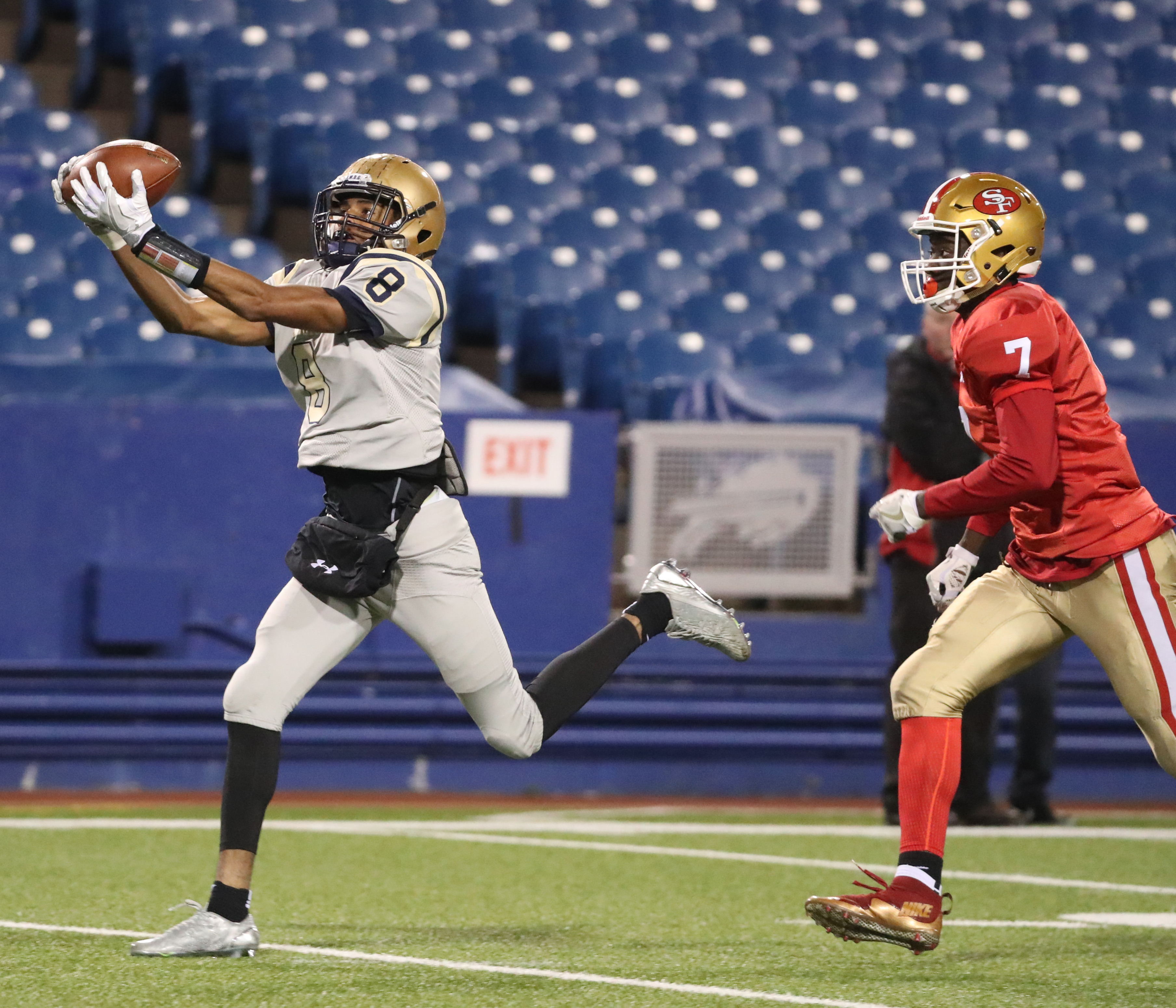 Paul Woods hauls in a 43-yard reception that led to Canisius first touchdown during the Crusaders triumph over St. Francis in the Monsignor Martin High School Athletic Association championship game at New Era Field. (James P. McCoy/Buffalo News)