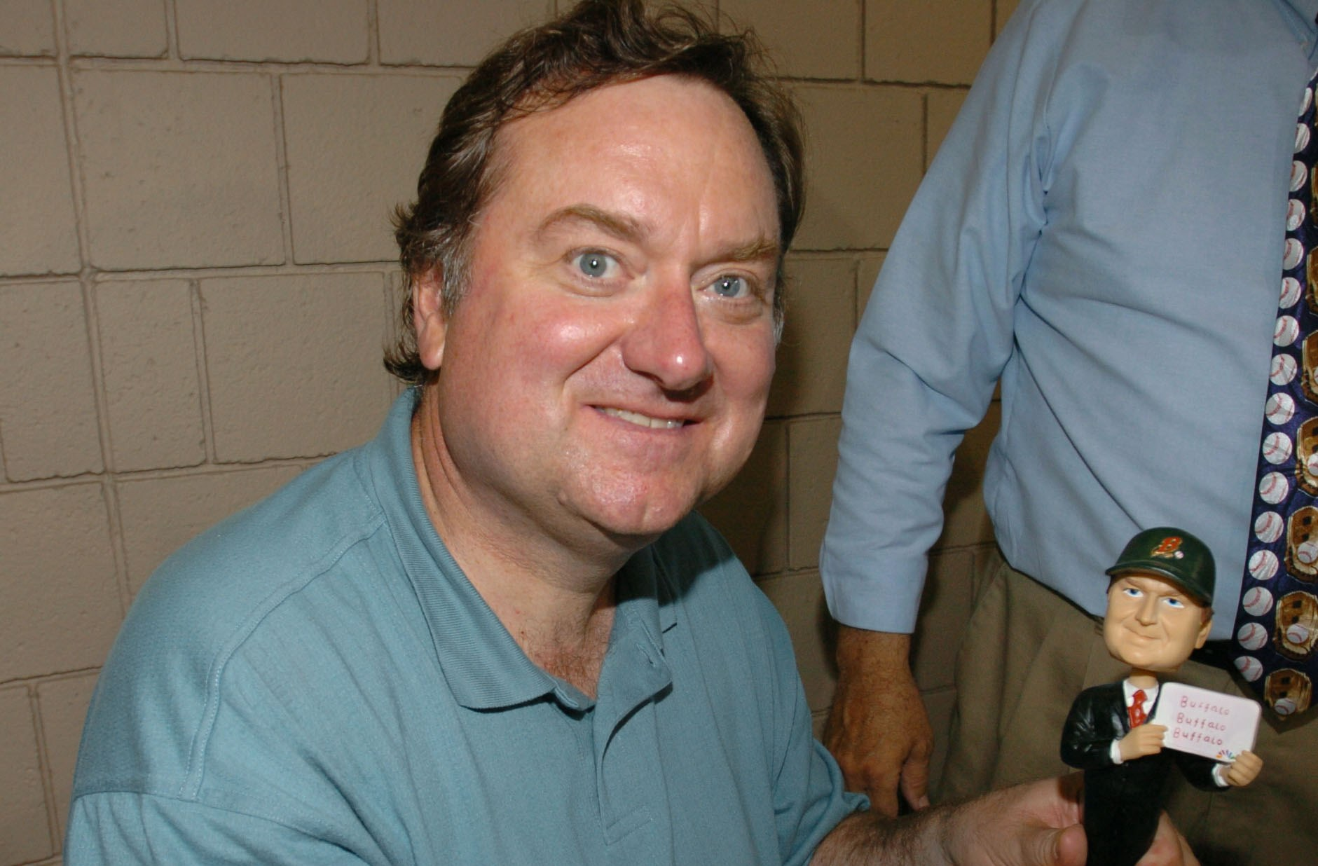 Tim Russert poses with his bobblehead doll that says 'Buffalo, Buffalo, Buffalo' on June 4, 2005, at a Buffalo Bisons game. (James P. McCoy/Buffalo News)