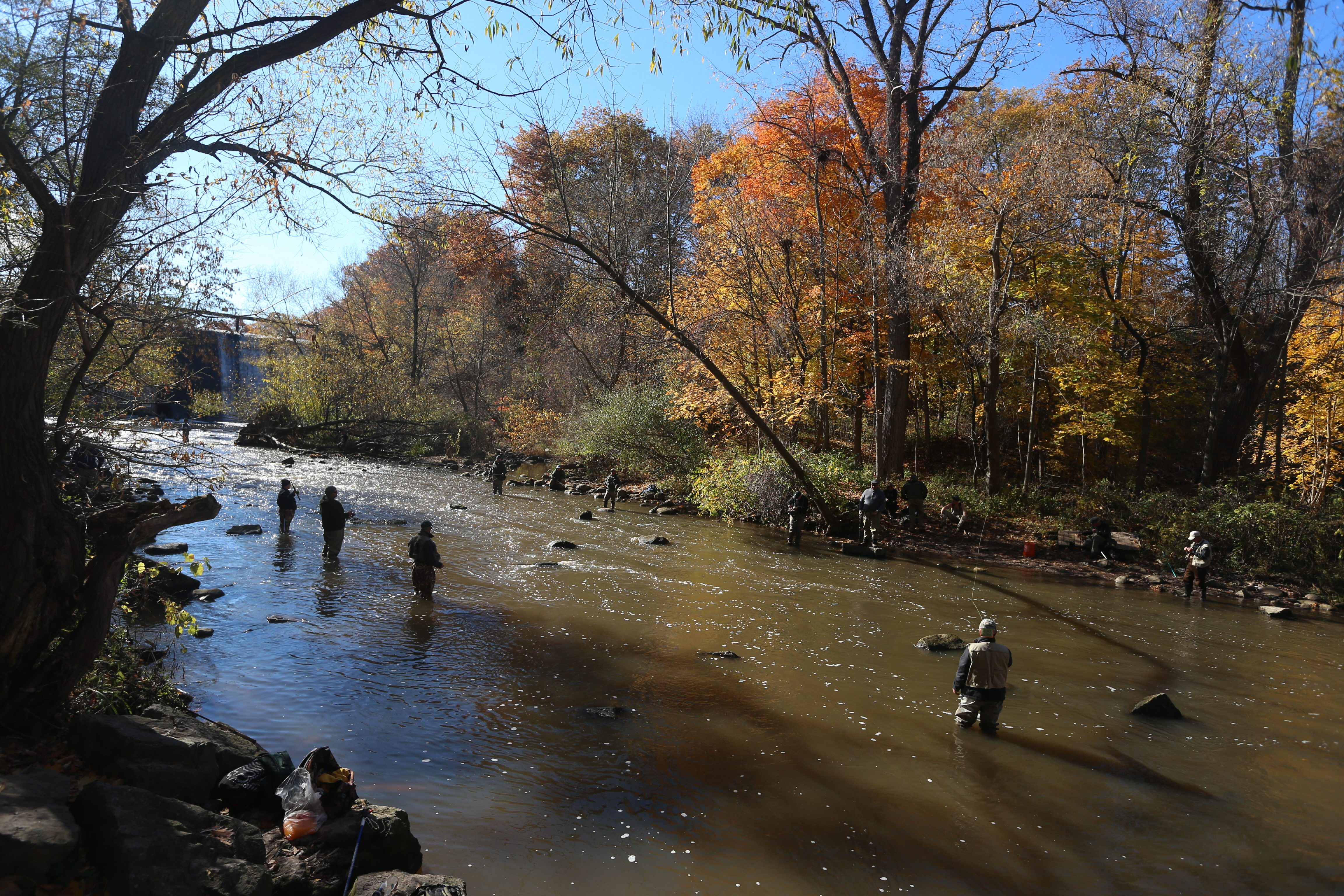 Fisherman on the banks of Burt Dam Fishermens Park on 18 Mile Creek in Burt, N.Y., on Monday, Nov. 2, 2015, fishing for brown trout and salmon. (John Hickey/Buffalo News)