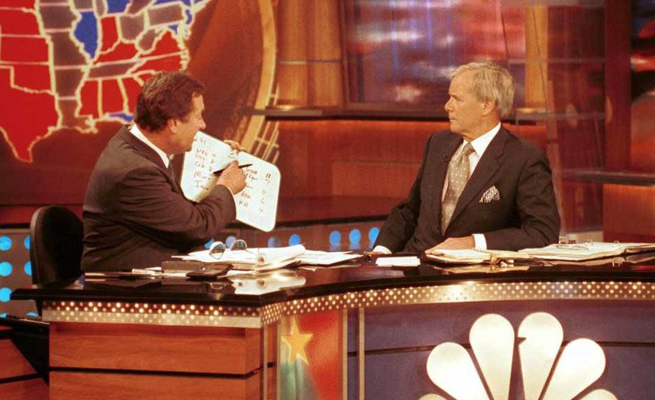 Tim Russert with his famous whiteboard and NBC's Tom Brokaw during election coverage in 2000. (Photo courtesy of NBC)