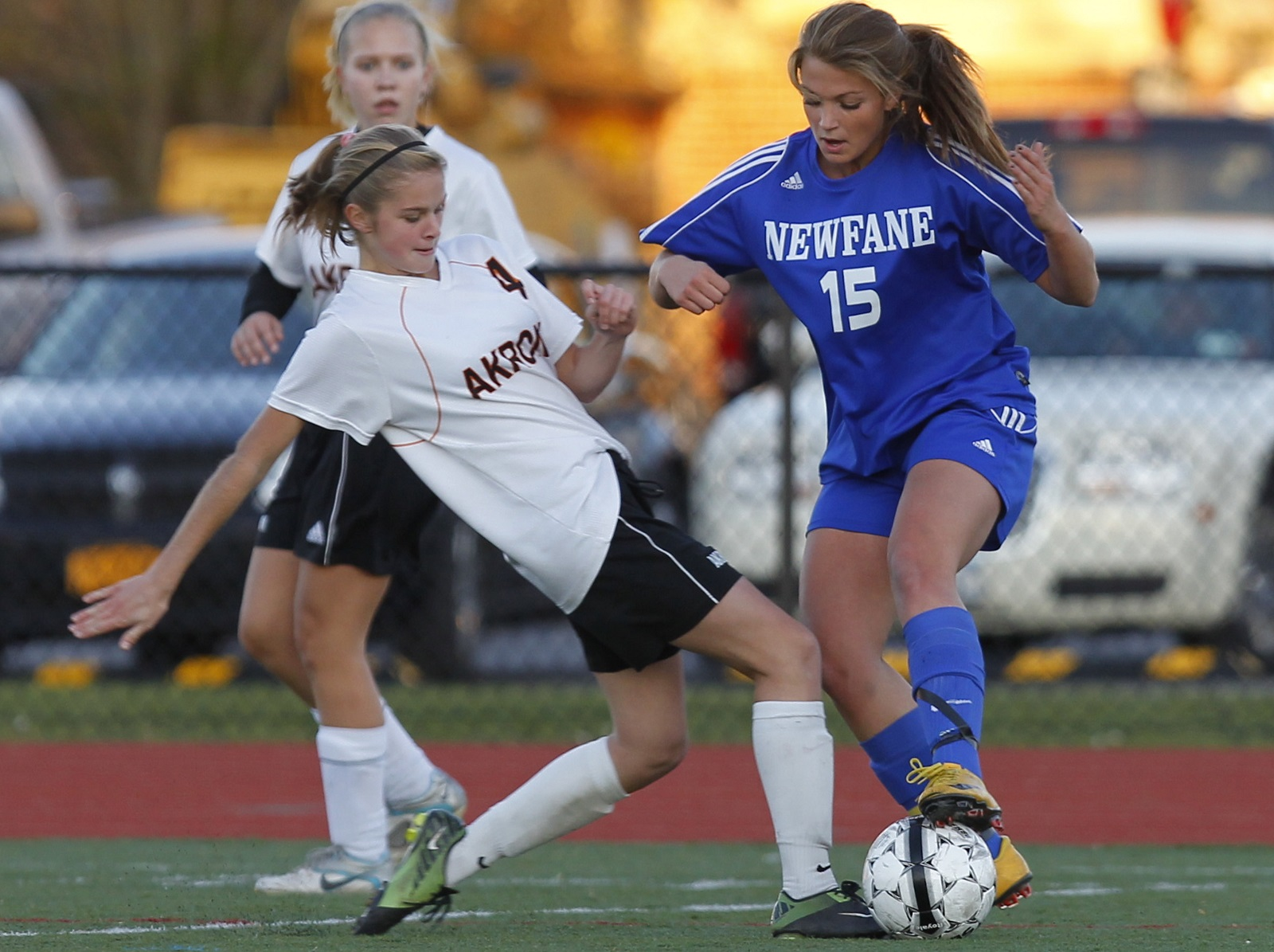 Newfane's Alexis Moreland, left, goes into a tackle in a 2011 playoff game. Moreland now plays at Fredonia. (John Hickey/Buffalo News file photo)