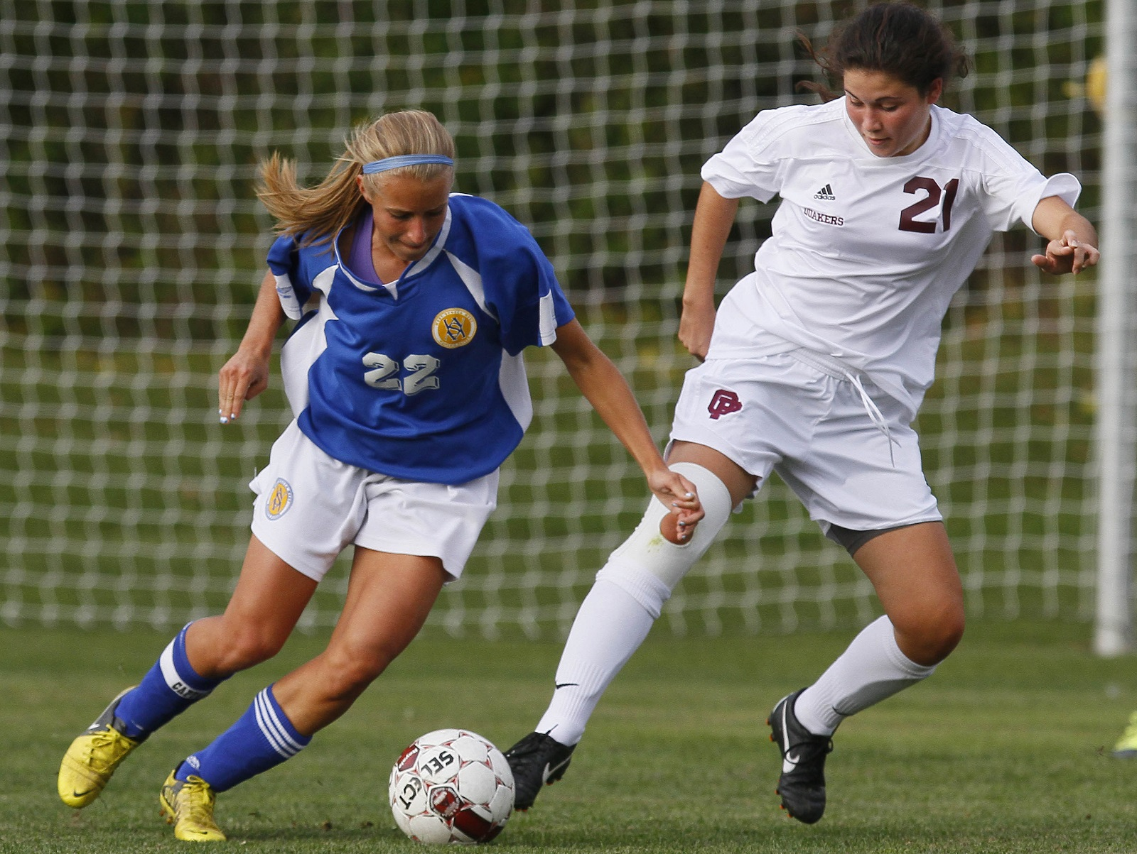 Orchard Park's Courtney Hartnett, right, tries to poke the ball away from West Seneca West's Nicolette Nigro in 2012. (Mark Mulville/Buffalo News file photo)