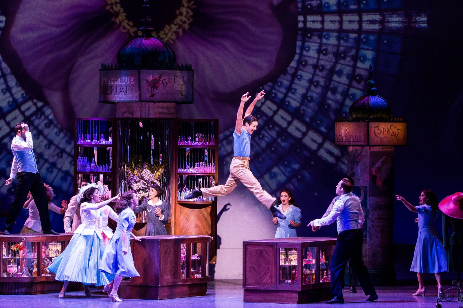 "Garen Scribner leaps across two set pieces in the touring production of ""An American in Paris."""