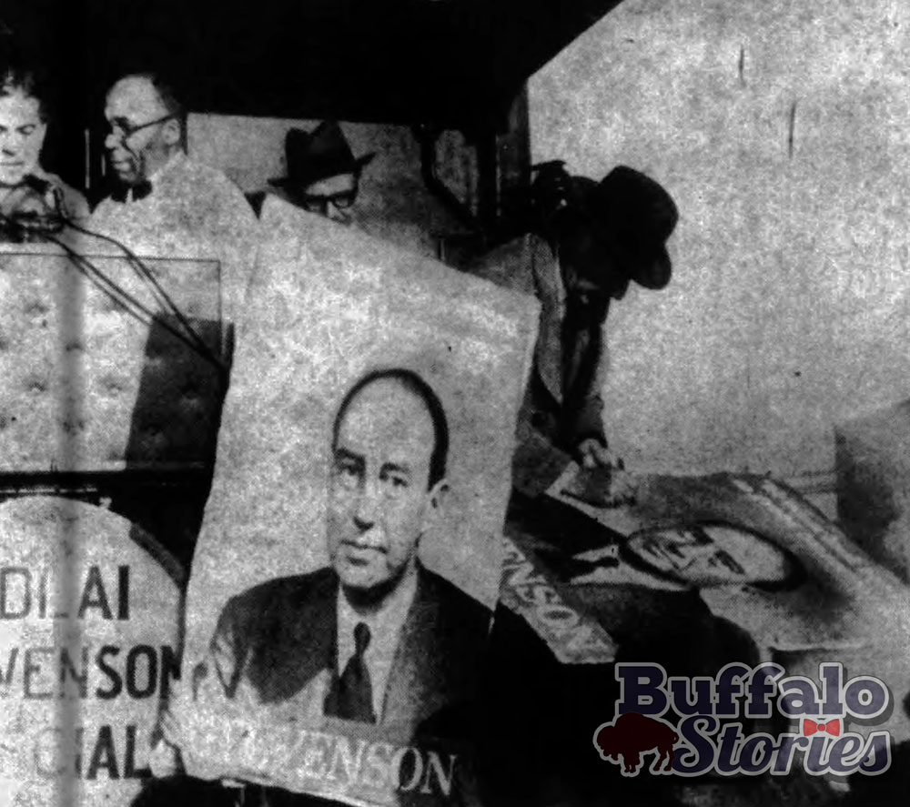 Adlai Stevenson signs a campaign poster from the back of his train in Niagara Falls. Stevenson spoke to about 1,000 people just outside Niagara Falls' New York Central Station.