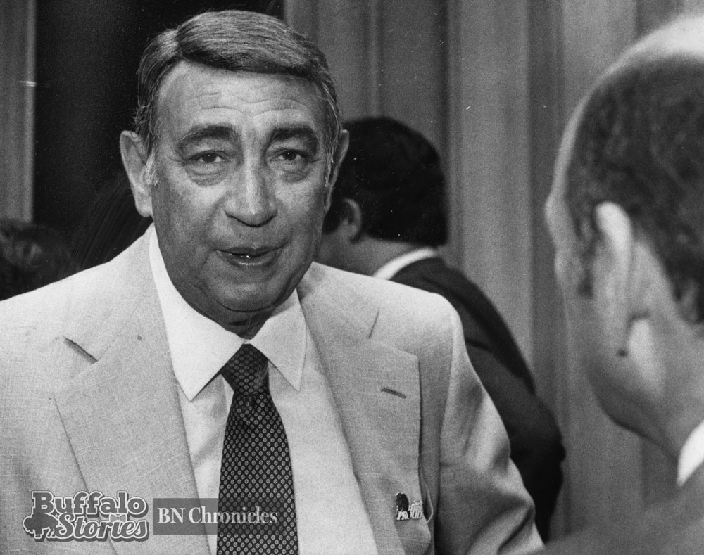 """Howard Cosell, wearing a """"Talking Proud"""" pin, speaks with Buffalo Mayor James D. Griffin. Buffalo News archives"""