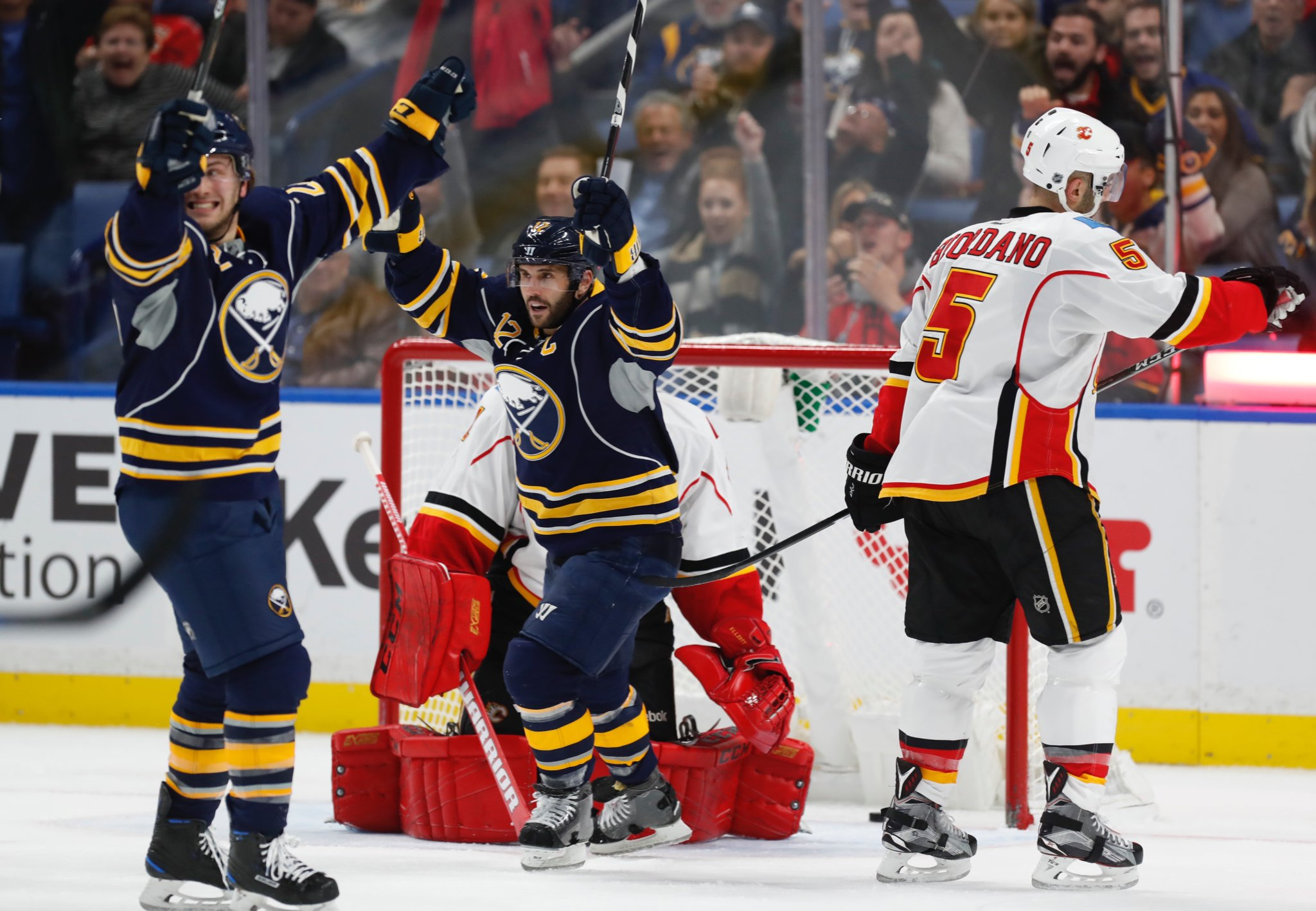 Johan Larsson, left, and Brian Gionta celebrate as Larsson puts the Sabres up, 2-1. (Harry Scull Jr./Buffalo News)