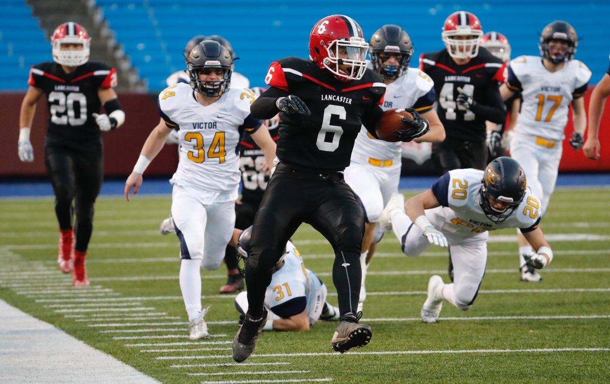 Leugim Castillo takes it to the house on an 84-yard kick return touchdown for Lancaster during its regional loss to state No. 1 Victor. (Harry Scull Jr./Buffalo News)