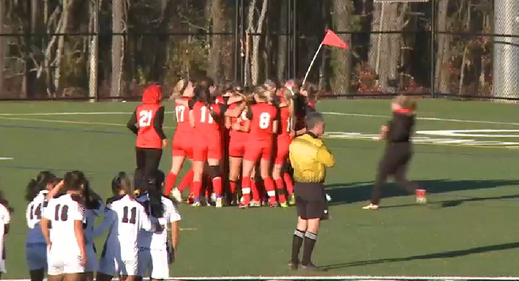 The Erie Community College women's soccer team celebrates its shootout victory over Montgomery Community College 4-3 in pens..