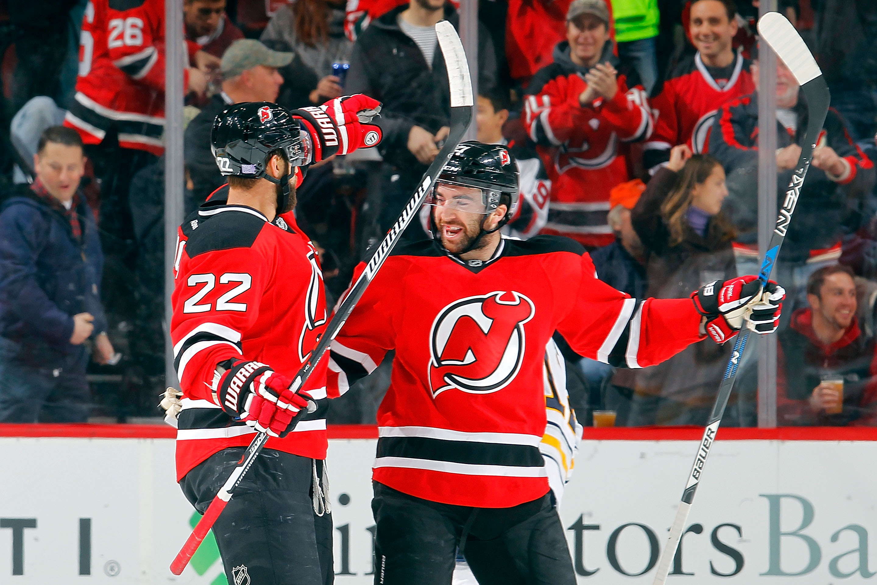 Kyle Quincey (22) and Kyle Palmieri both scored for the Devils against the Sabres.  (Getty Images)
