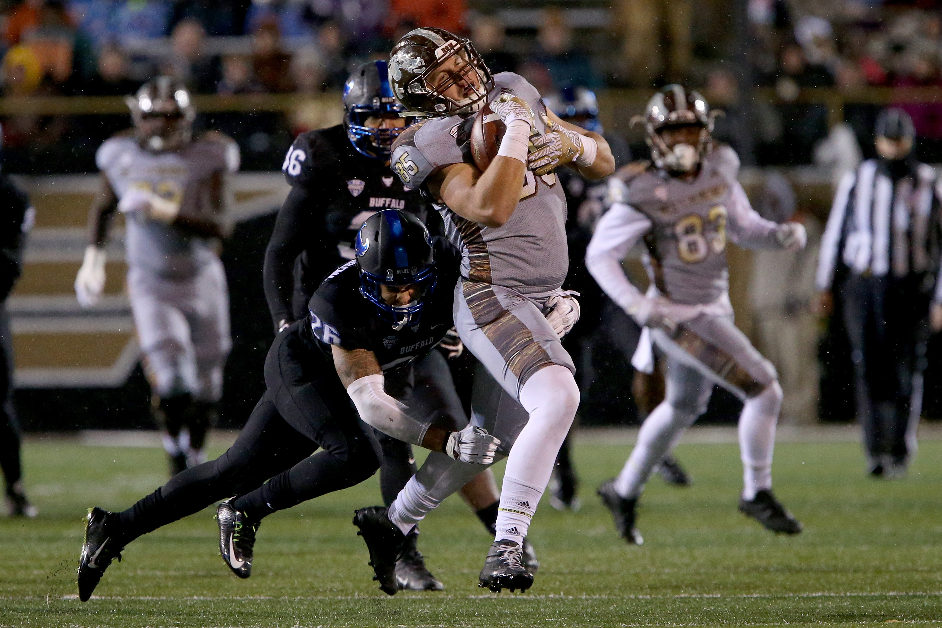 Western Michigan's Donnie Ernsberger makes a catch in front of Buffalo's Ryan Williamson in the third quarter at Waldo Stadium. (Photo by Dylan Buell/Getty Images)