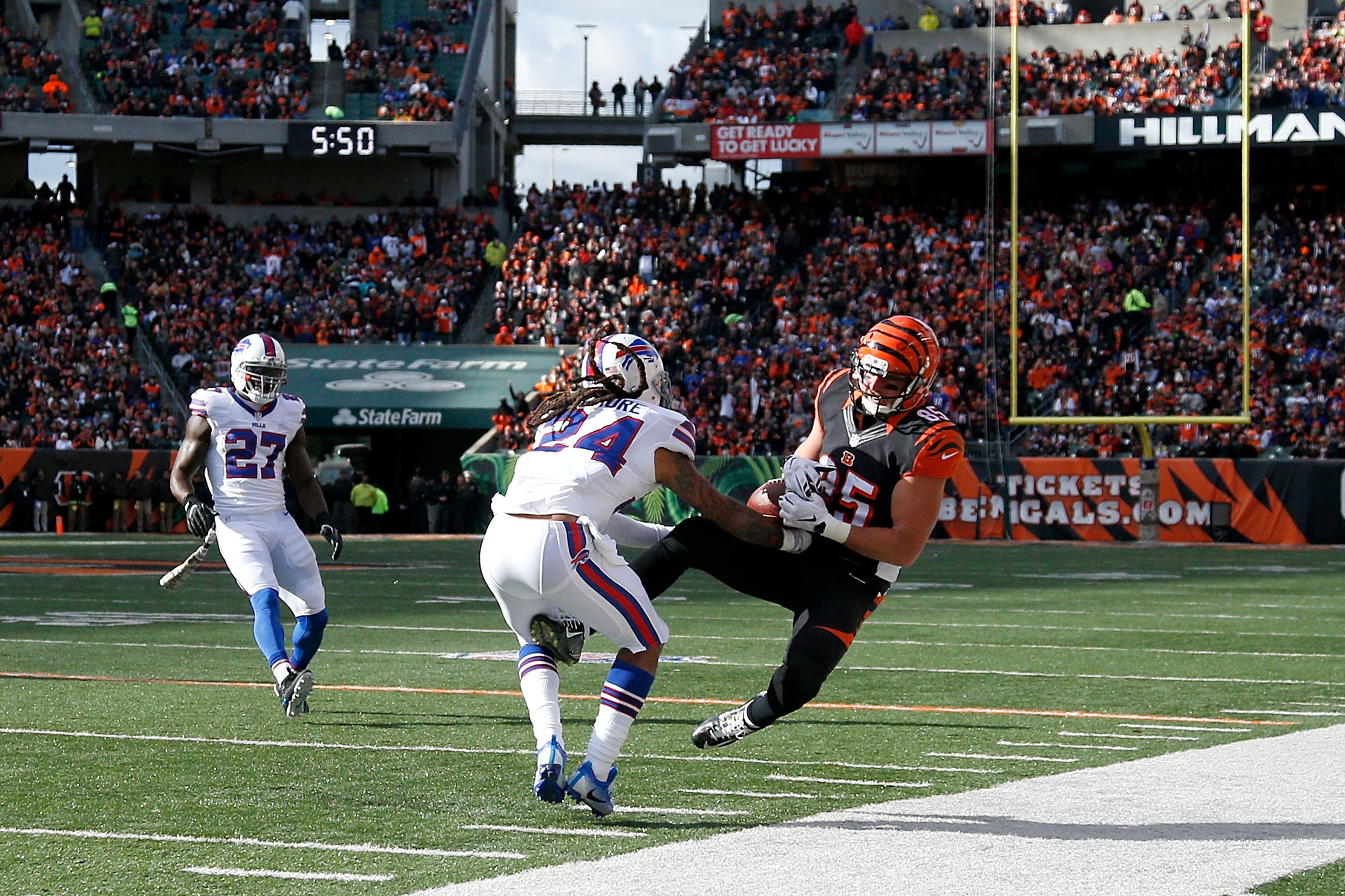 Tyler Eifert of the Cincinnati Bengals is hit by Stephon Gilmore after a catch in the second quarter. (Getty Images)