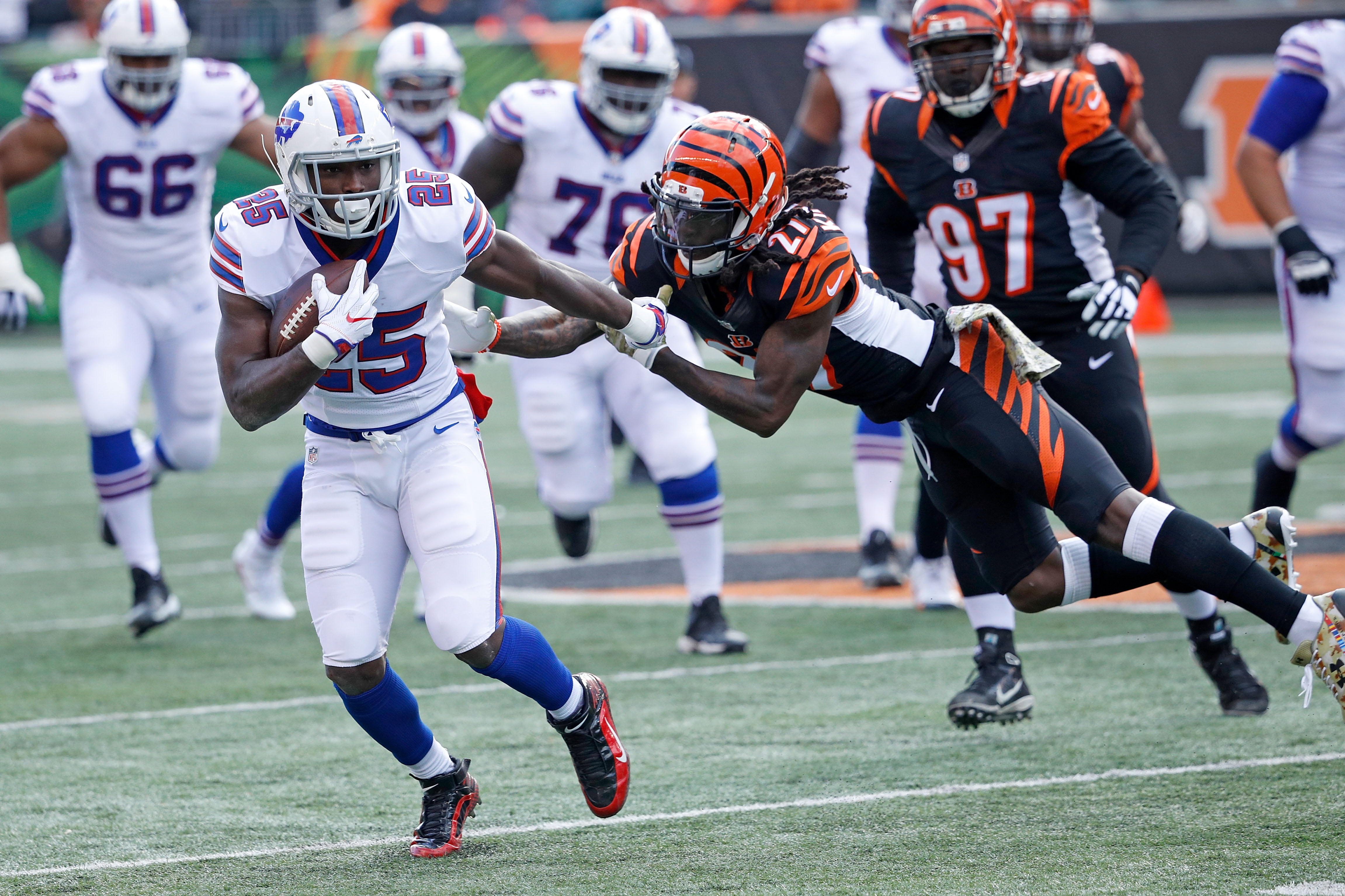 LeSean McCoy breaks a tackle by Dre Kirkpatrick of the Cincinnati Bengals during the second quarter. (Getty Images)