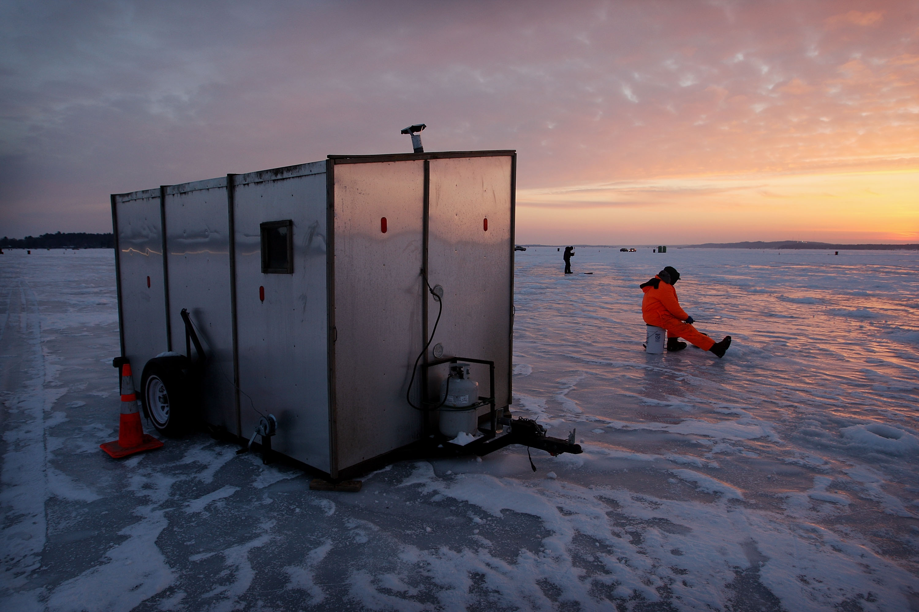 Ice fishing is really catching on … at least when the weather cooperates! (Getty Images)
