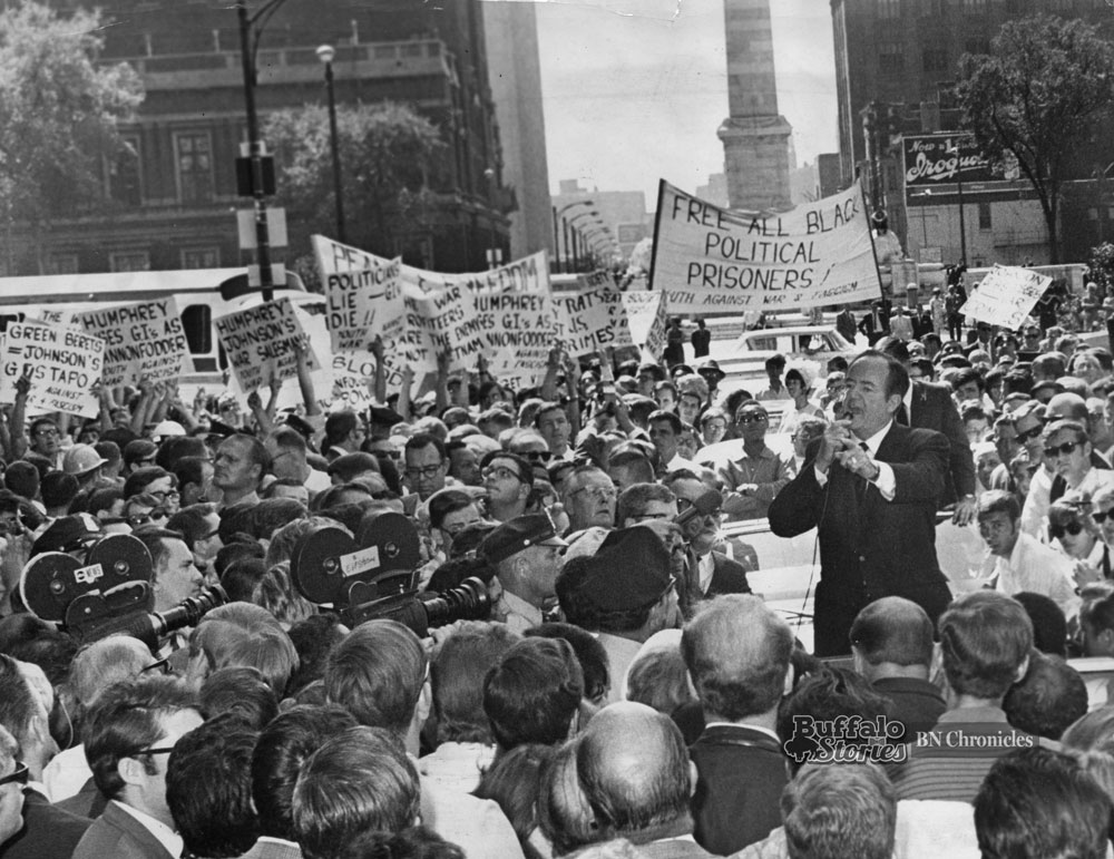 Hubert Humphrey speaks with anti-Vietnam War protestors, standing on Delaware Avenue, just off Niagara Square in front of the Statler Hotel in September, 1968.