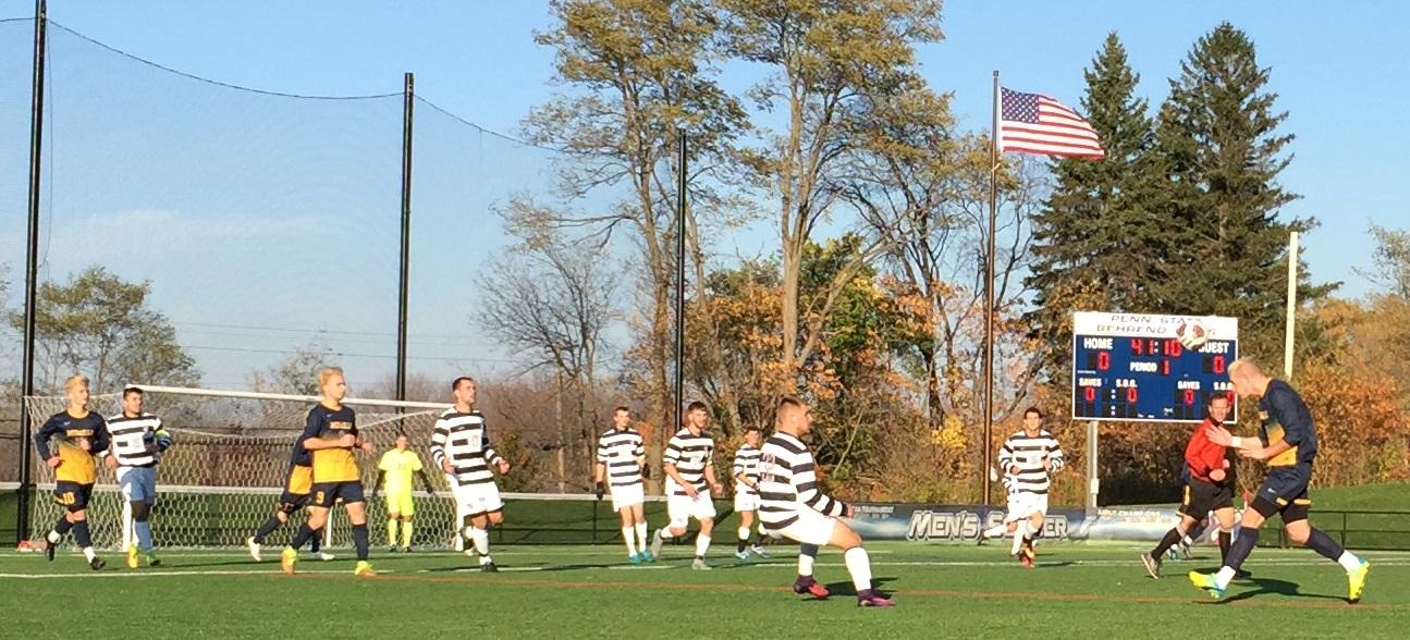Mick Lennox. far right, heads the ball forward for Medaille. (Ben Tsujimoto/Buffalo News)