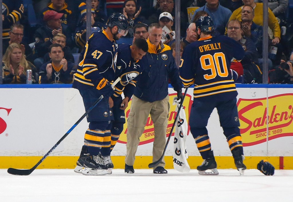 Rich Stinziano has already given medical help to Zach Bogosian, left, Evander Kane and Ryan O'Reilly. (Harry Scull Jr./Buffalo News)