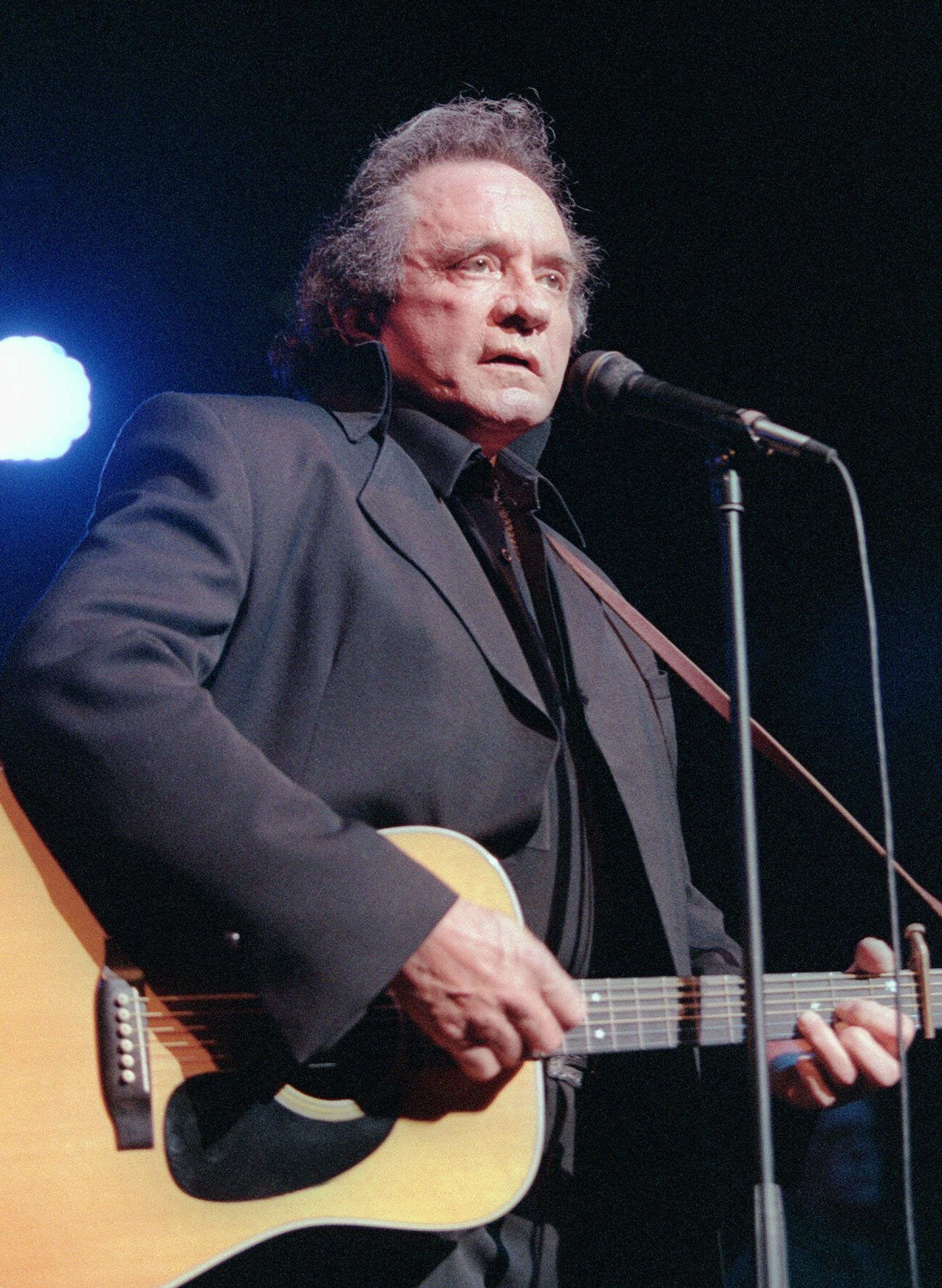 Johnny Cash performing in 1997 (Daniel Janin/Getty Images)