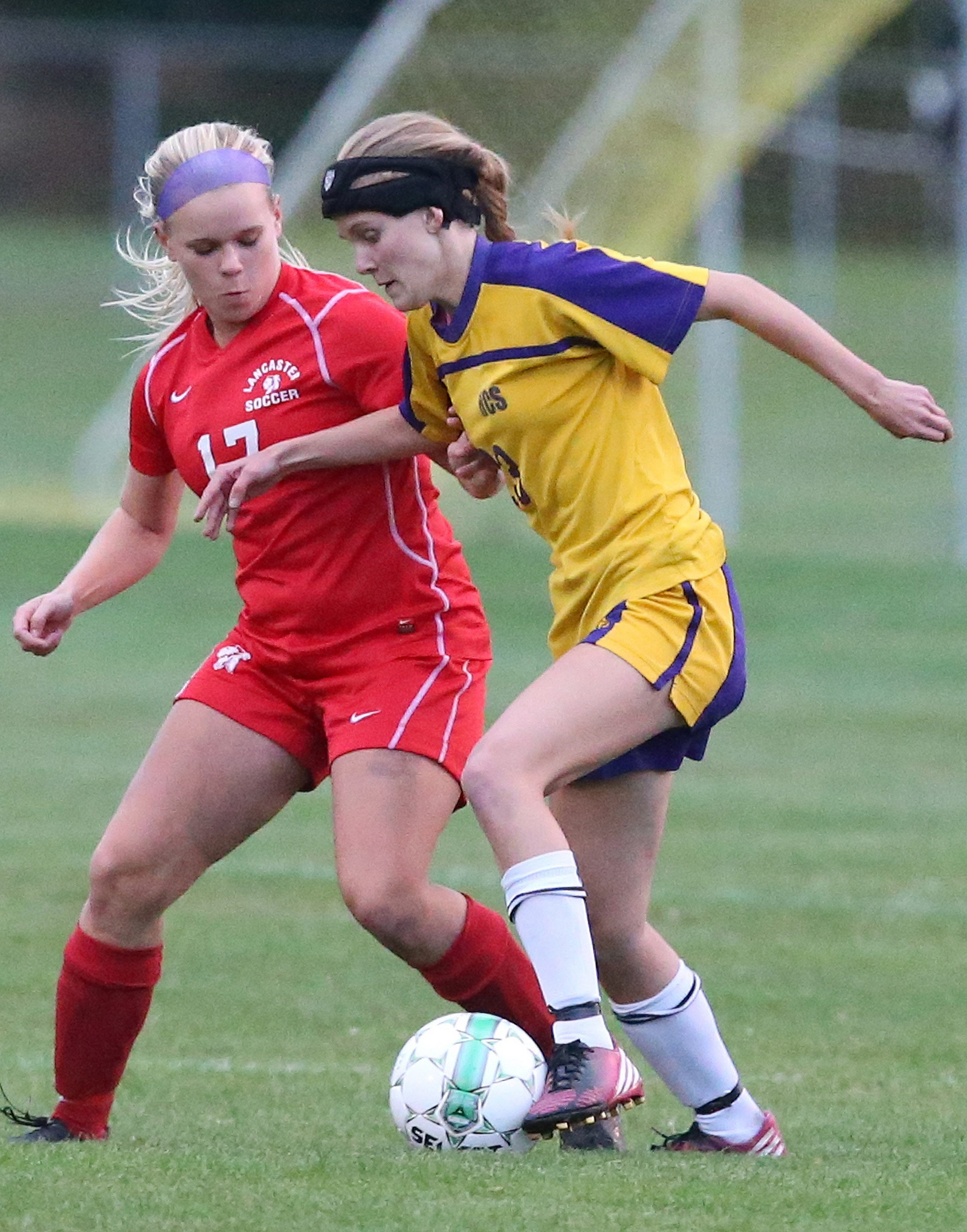 Holland's Olivia Schmidt, right, shields the ball in a 2014 high school soccer match. Schmidt now plays at Indiana Wesleyan. (James P. McCoy/Buffalo News file photo)