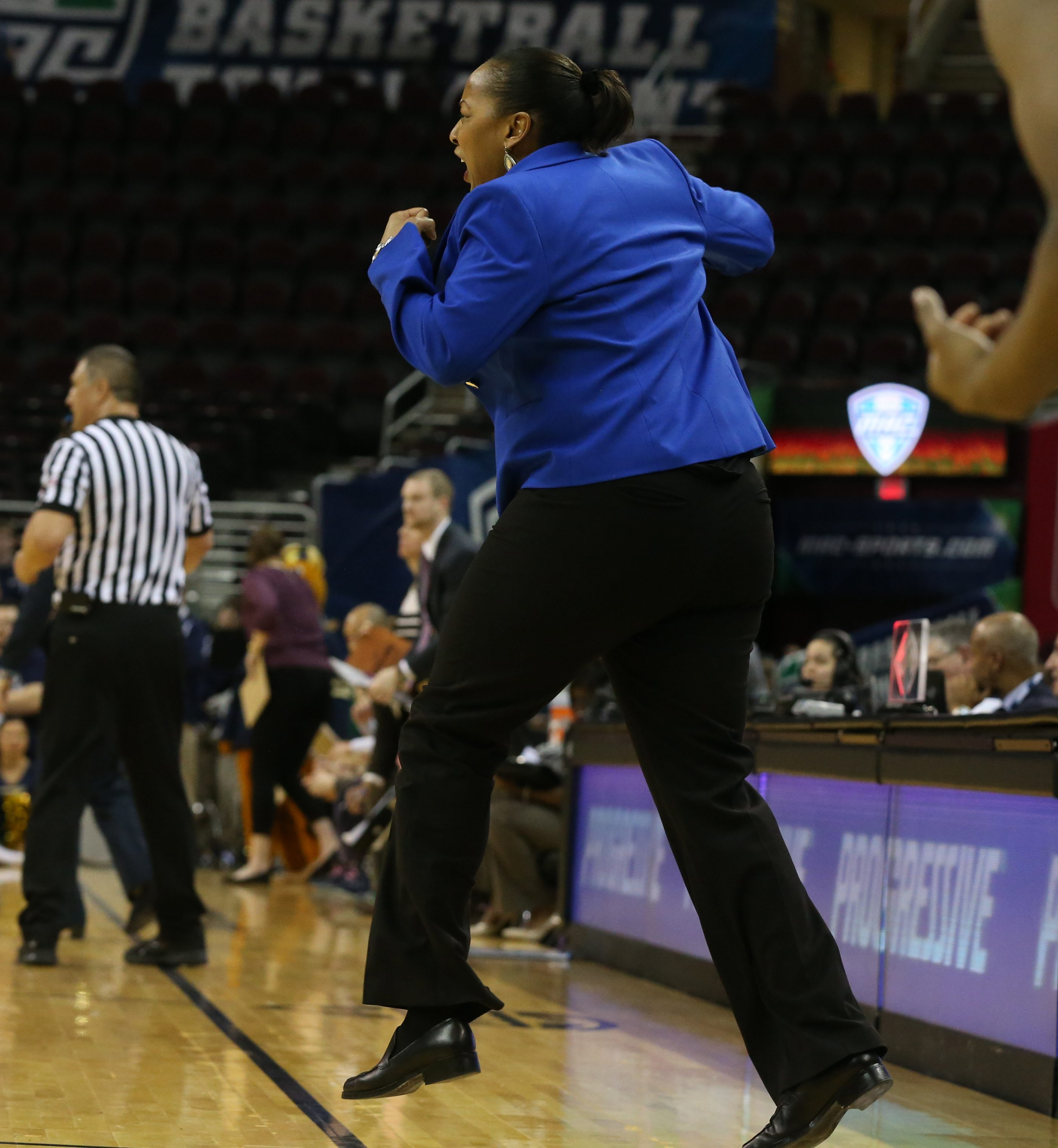 Buffalo Bulls head coach Felisha Legette-Jack celebrates in the final seconds of the semi final. UB won 88-87 to advance to the MAC Championship on Saturday at Quicken Loans Arena in Cleveland,NY on Friday, March 11, 2016. (James P. McCoy/ Buffalo News)