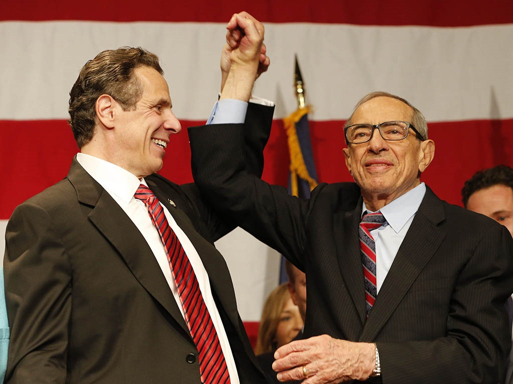 Gov. Andrew Cuomo and his father, former Gov. Mario Cuomo,  celebrate at the Sheraton New York Times Square in New York City after Andrew's re-election. Mario died in 2015. (Derek Gee/Buffalo News)