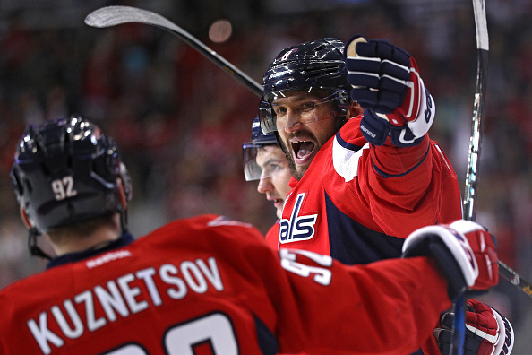Alex Ovechkin celebrates his hat trick Wednesday against St. Louis with Evgeny Kuznetsov (Getty Images).