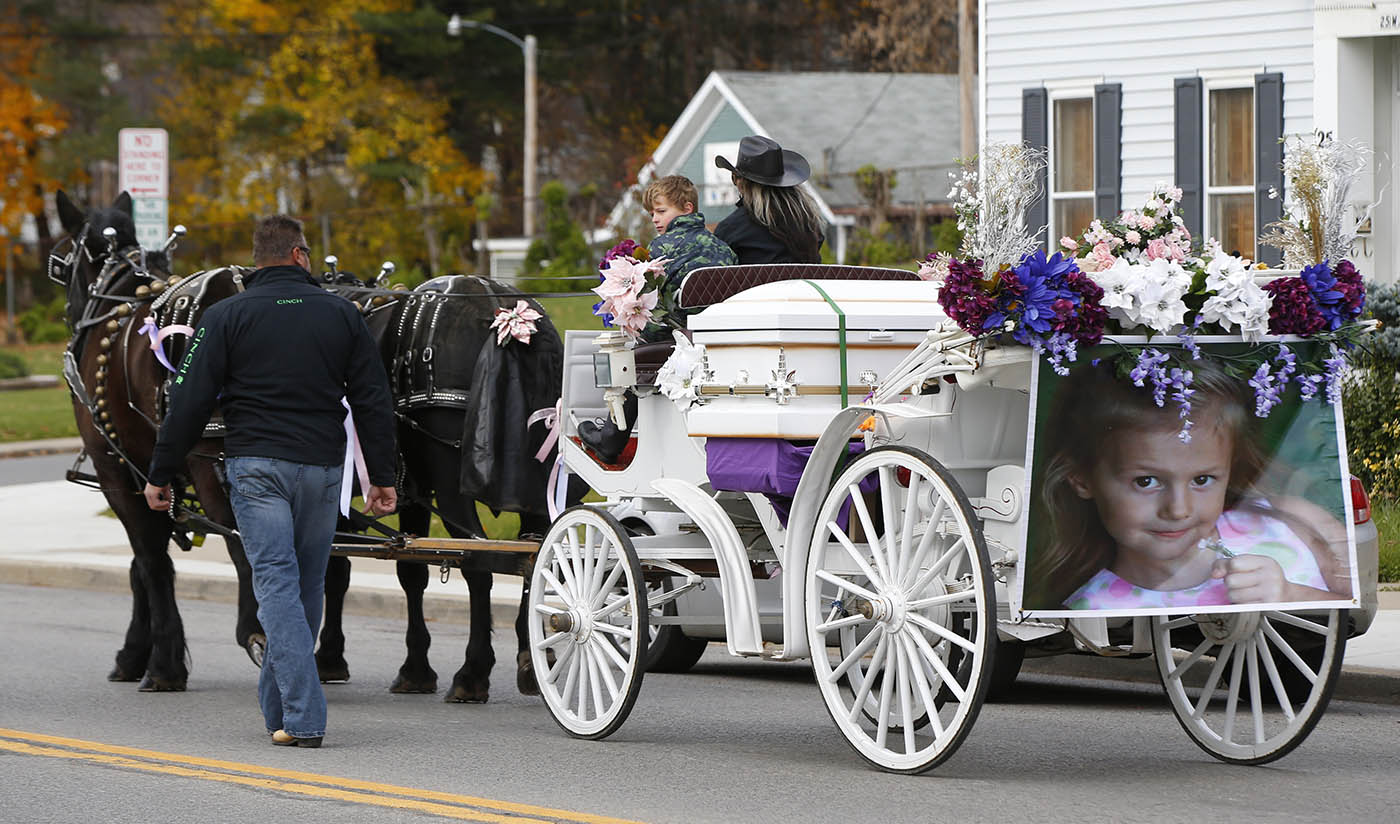 A horse drawn carriage carrying the casket of Alyssa Hearn makes its way down West Main Street in Springville,NY on Friday, Nov. 11, 2016. Alyssa Hearn, 7, was hit and killed by her school bus on West Main Street last Friday(Harry Scull Jr./Buffalo News)