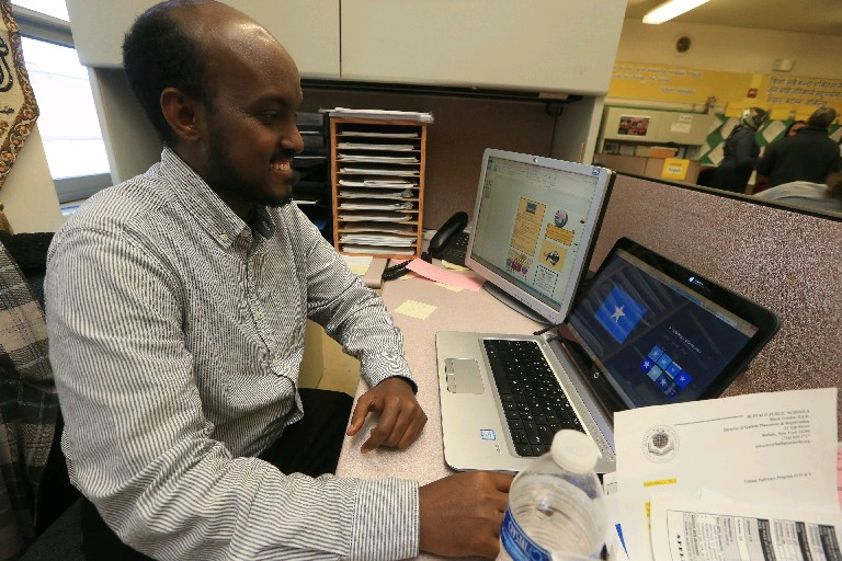 Cultural aide Abdi Yakub speaks Somali and is one of six new language specialists the Buffalo schools have hired to help immigrant and refugee students register.
