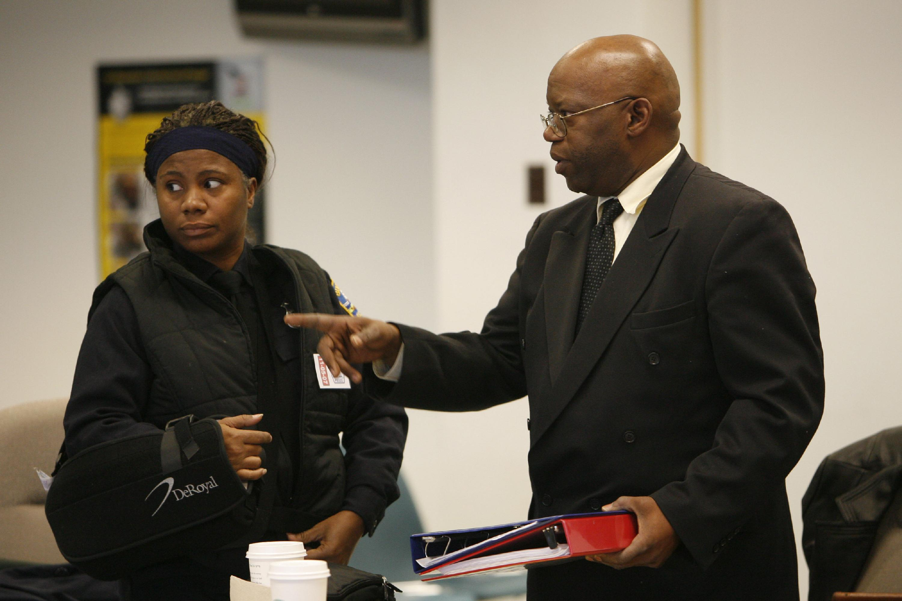 Cariol Horne talks with one of her lawyers in 2007. (Buffalo News photo/Derek Gee)