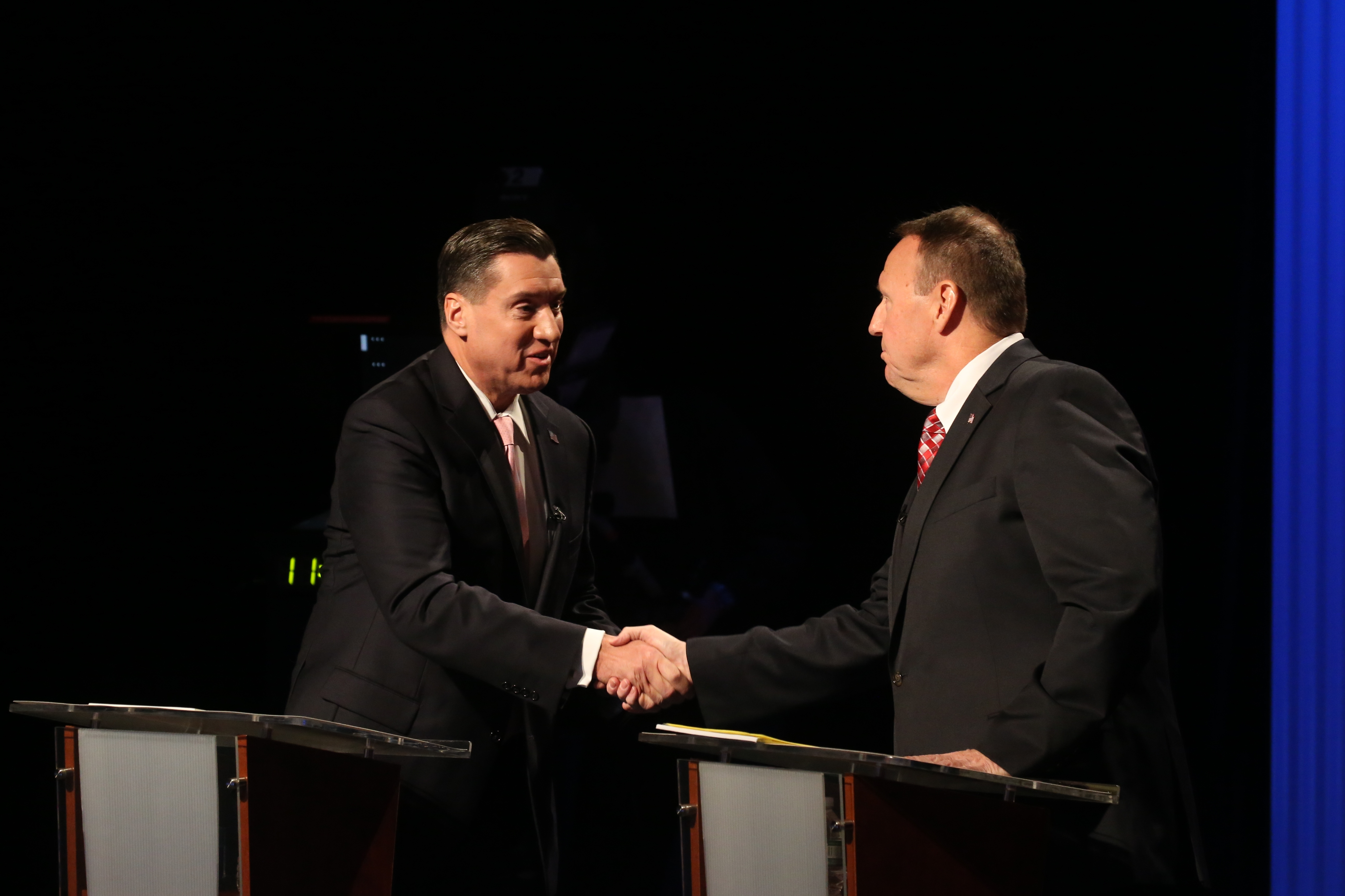 District attorney candidates John Flynn, left, and Joseph Treanor III shake hands after a debate between the two at WNED Studios on Oct. 27, 2016. (John Hickey/Buffalo News)