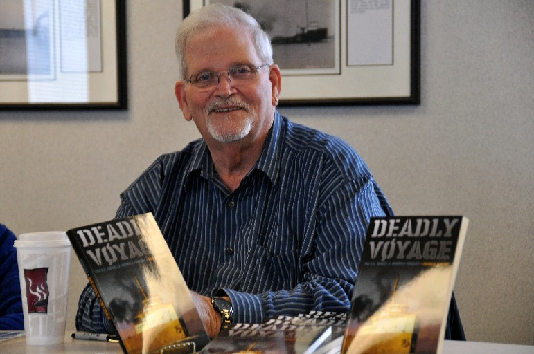 "Sole survivor Dennis Hale with the book ""Deadly Voyage,"" which told the story of the 1966 shipwreck that killed 28. Hale died last year."