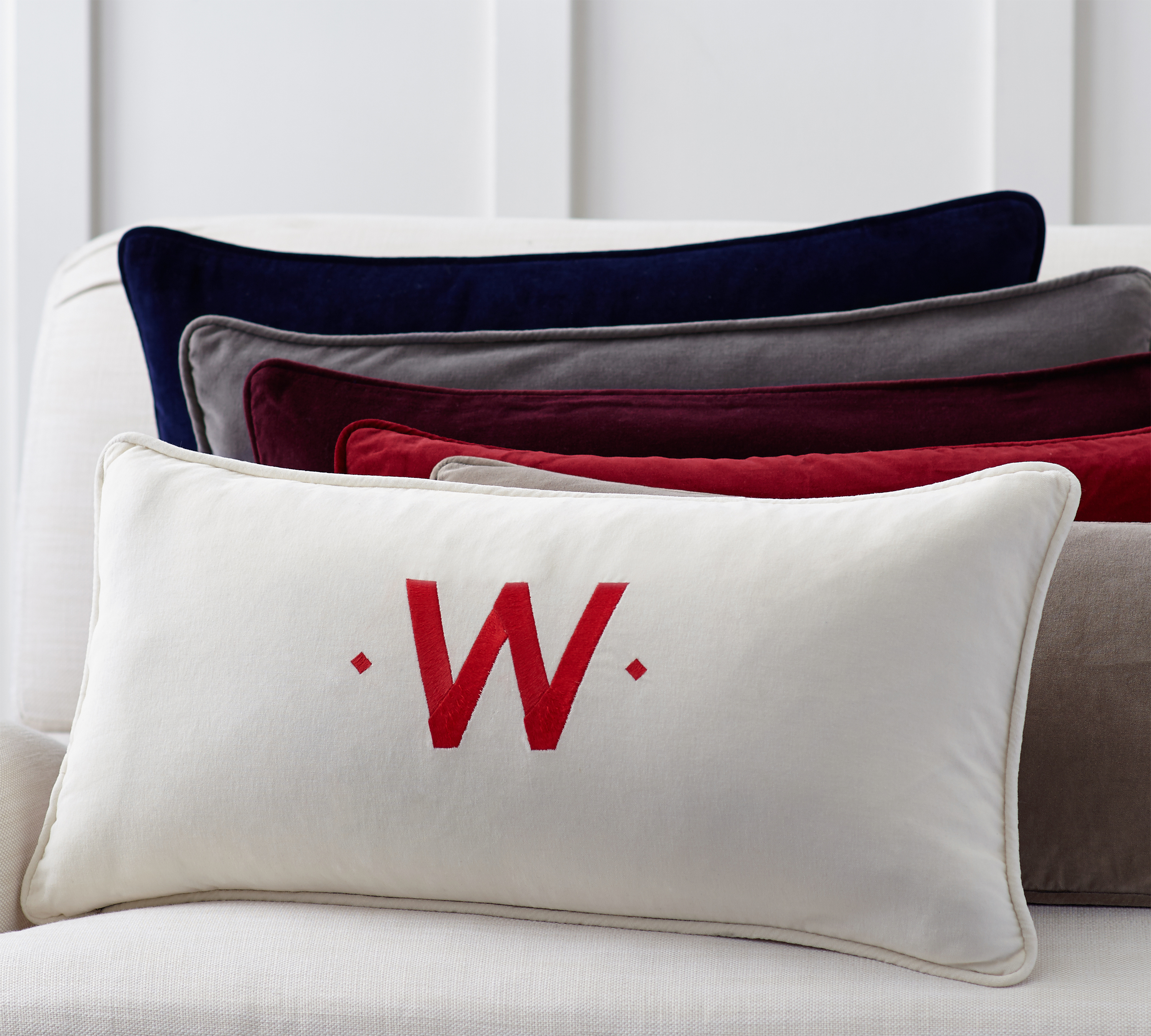 Pottery Barn's Solid Velvet Lumbar Pillow Cover comes in a selection of colors and can be monogrammed ($29.50 for the pillow cover at potterybarn.com.) Insert sold separately.  Photo from Pottery Barn.