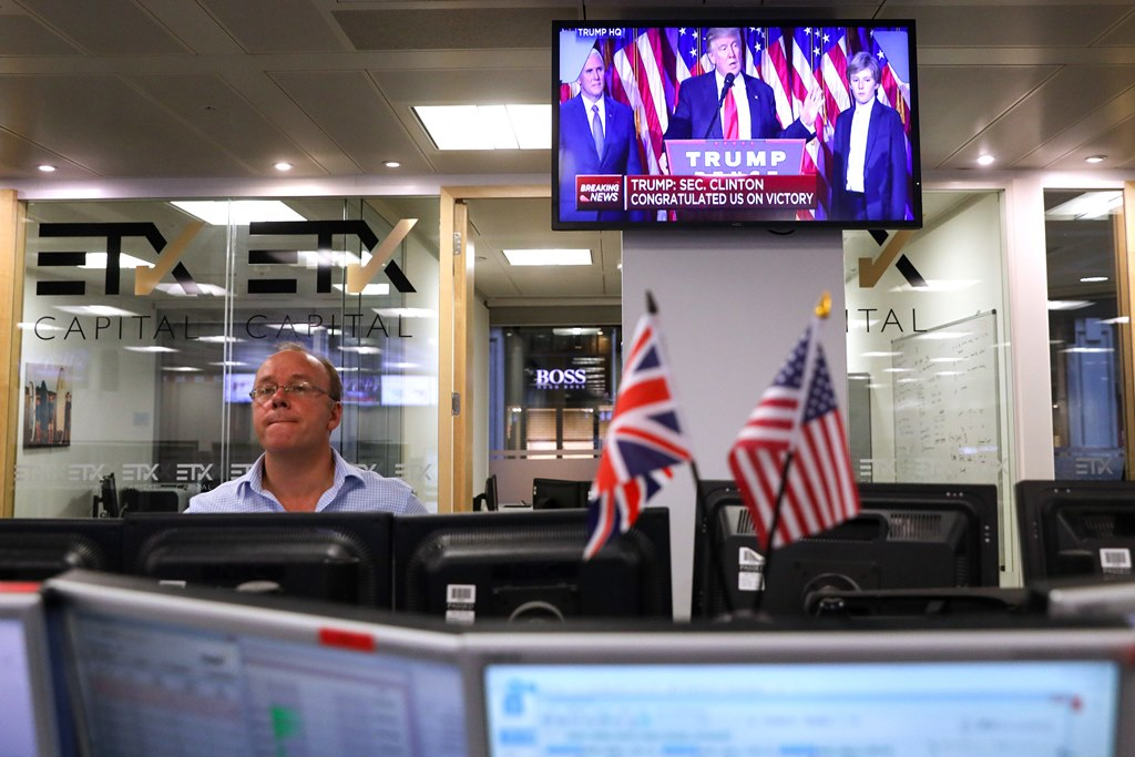 A television screen on the trading floor at ETX Capital in London displays a news channel showing President-elect Donald Trump making his victory speech on Nov. 9, 2016. (Bloomberg photo by Chris Ratcliffe)