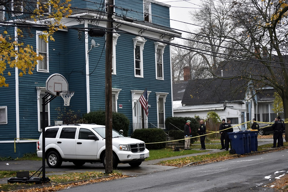 Investigators are on scene of a fire on Cottage Street where someone was found dead on Friday morning. (Larry Kensinger/contributor)