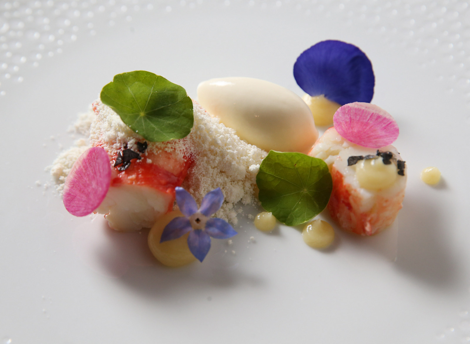 Oliver's Executive Chef Ross Warhol offers Tasting Tuesdays, five or seven courses of creative cuisine like this recent dish: chilled king crab leg, lemon puree, white chocolate powder, shaved watermelon radish and white asparagus ice cream. (Sharon Cantillon/Buffalo News)