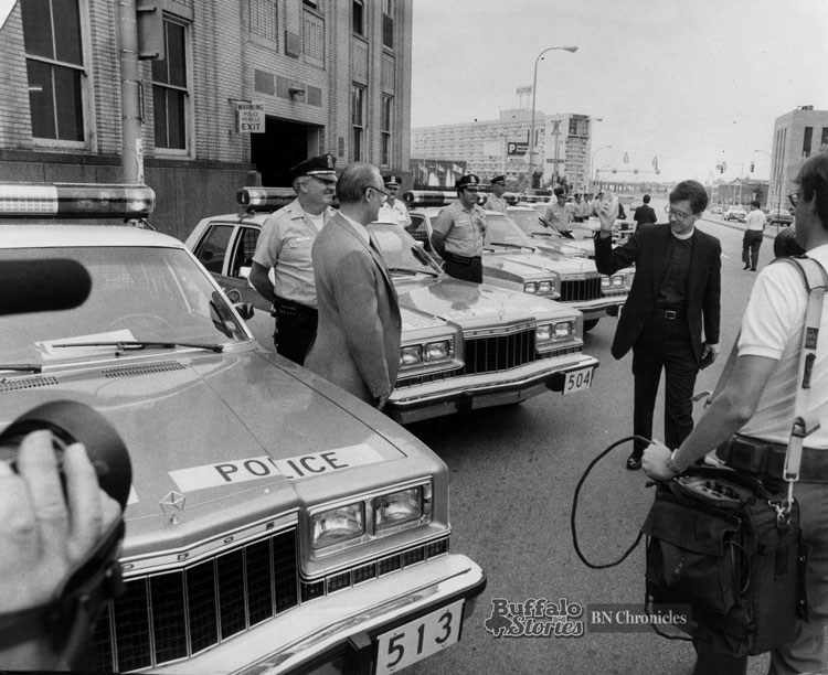 As Police Commissioner Ralph V. Degenhart looking on, the Rev. Jacob Ledwon blesses new police cars in 1985 outside the building that has served as Buffalo Police Headquarters since 1937.  Buffalo News archives