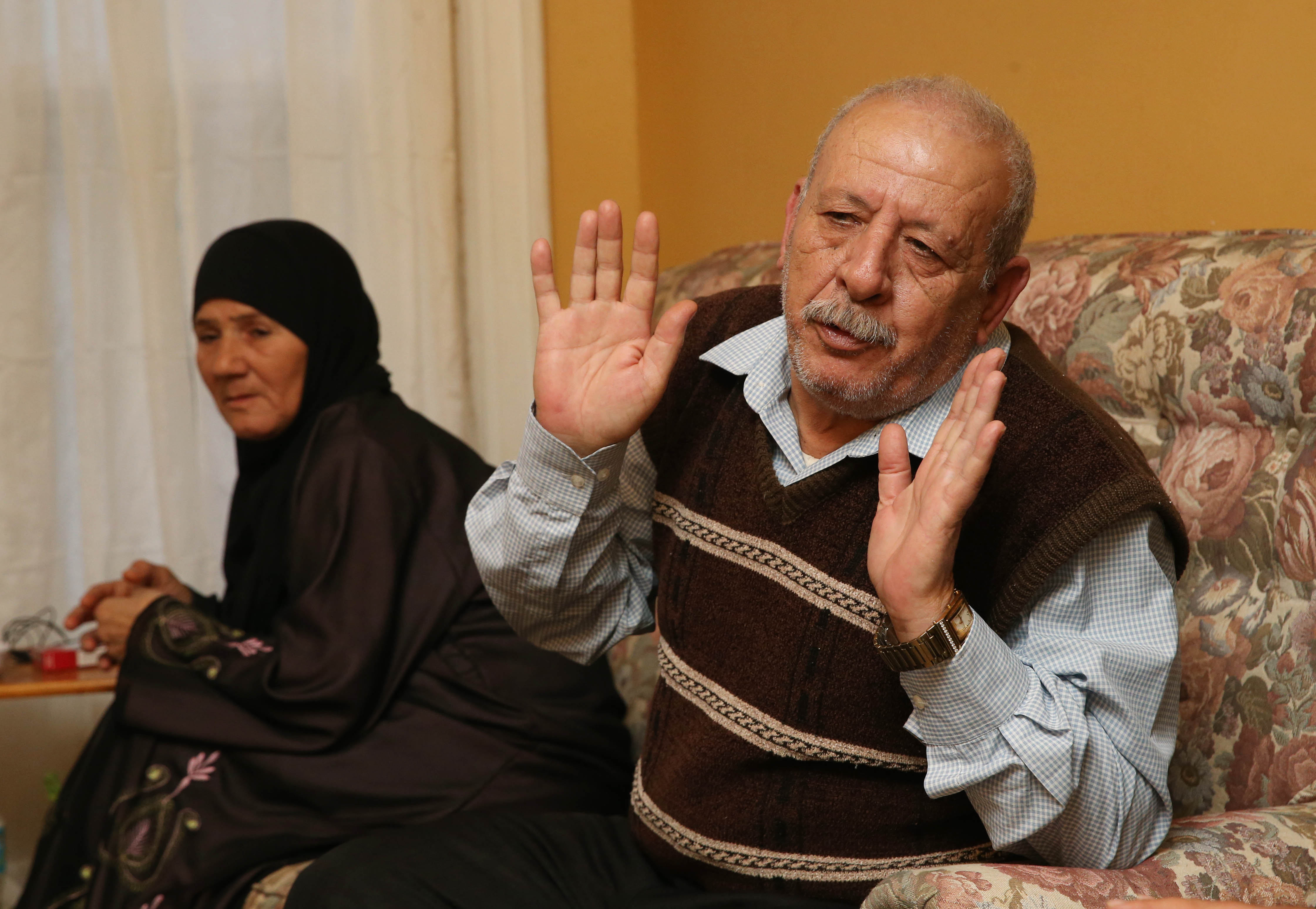 The Ay Toghlo family, refugees from Syria, are now residents on Buffalo's West Side. From left are Eidah Al Suleiman, 54, and her husband Mohammed Ay Toghlo, 67.  They talk about how they came to the United States and how happy they are to be here.  (Sharon Cantillon/Buffalo News)