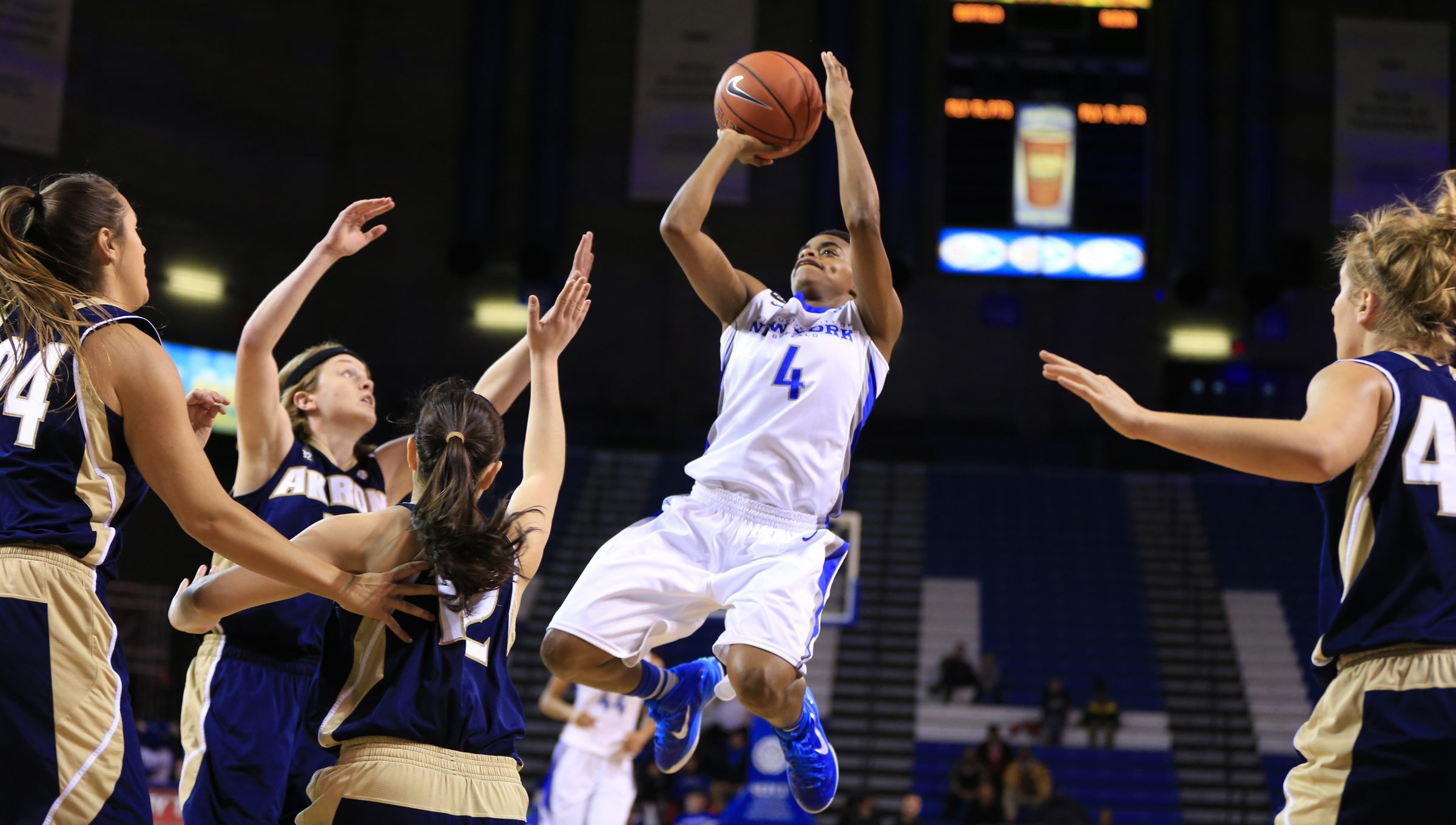 university at Buffalo's Joanna Smith (4) shoots between Akron players during first half action at Alumni Arena on Saturday, Feb. 28, 2015.(Harry Scull Jr./Buffalo News)