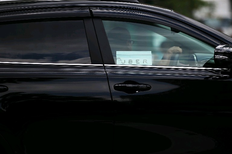 An Uber vehicle is viewed in Manhattan in July 2015 in New York City.(Spencer Platt/Getty Images)