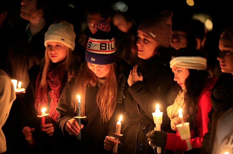 Friends and family attend a vigil for Nolan Burch in Amherst after the 18-year-old freshman died in a hazing initiation at West Virginia University. (News file photo)