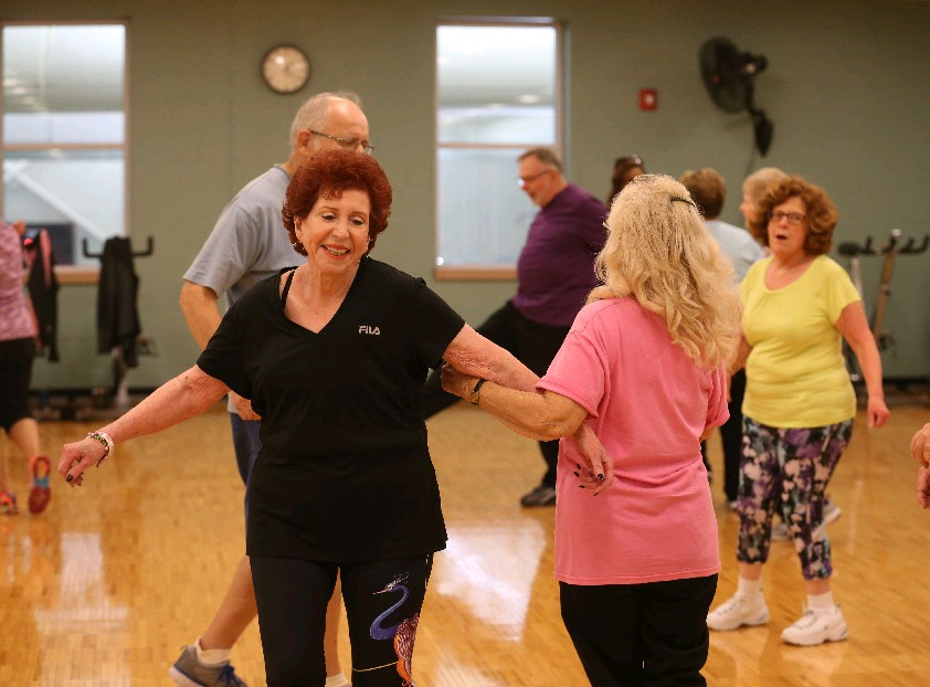 Loretta Kaminsky, left, has come off her cholesterol medication since she started teaching Zumba Gold about three years ago.