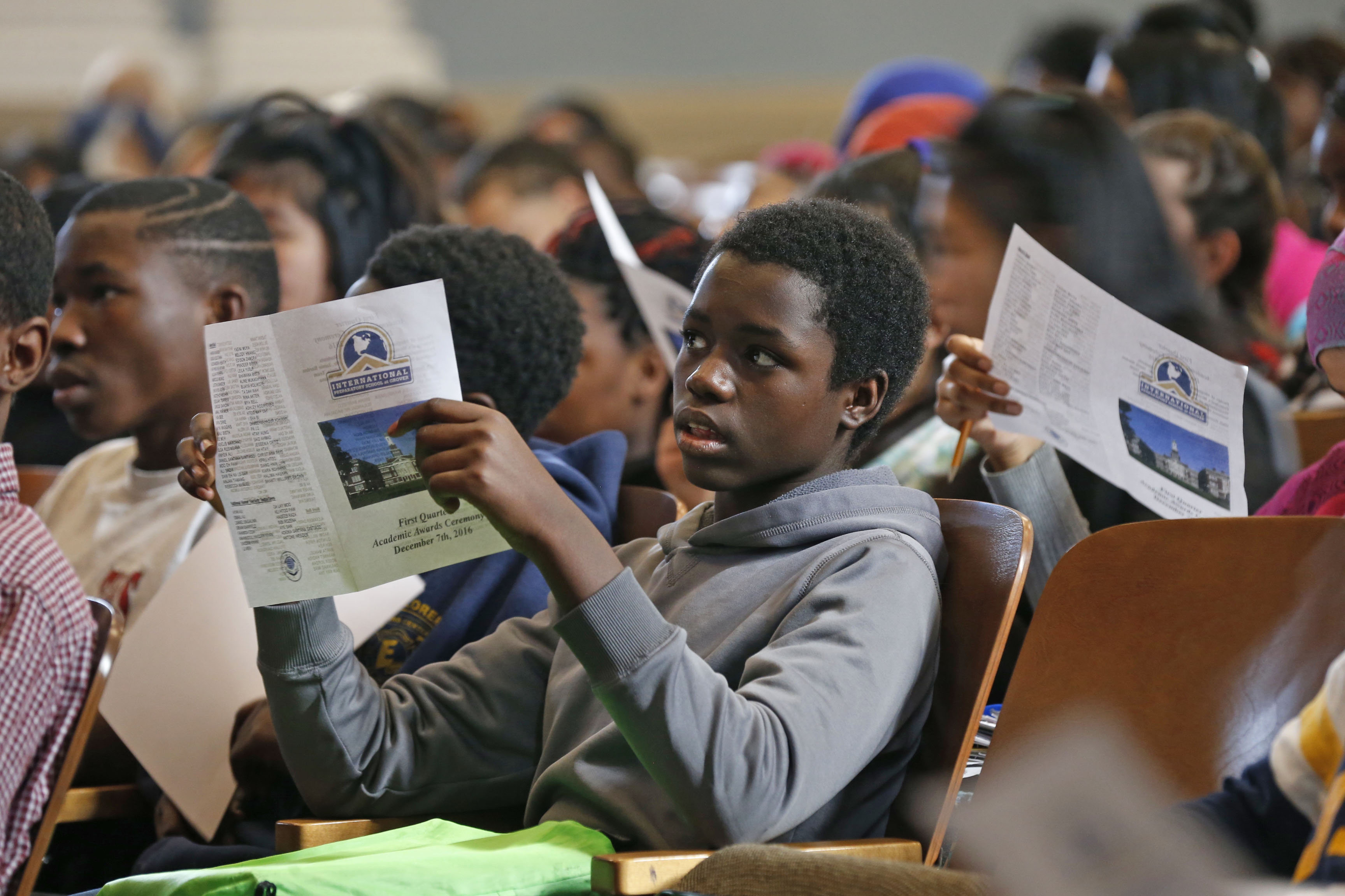 I-Prep freshman Vincent Munyaneza, 14, sits at an assembly waiting for his name to be called during a merit and honor society celebration in the school's auditorium  on Wednesday, Dec. 7, 2016.  (Robert Kirkham/Buffalo News)